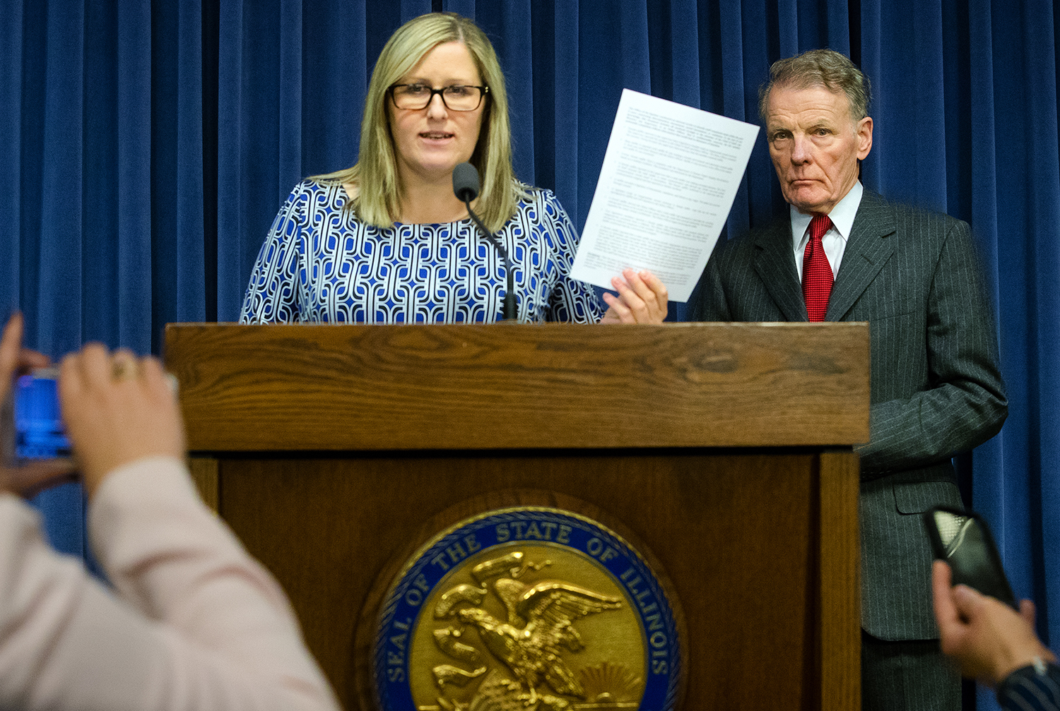 Illinois House Speaker Michael Madigan listens as attorney Heather Wier Vaught  discusses a list of sexual harassment complaints in Speaker Madigan's office in the last five years that was distributed to reporters Tuesday, Feb. 27, 2018. [Ted Schurter/The State Journal-Register]