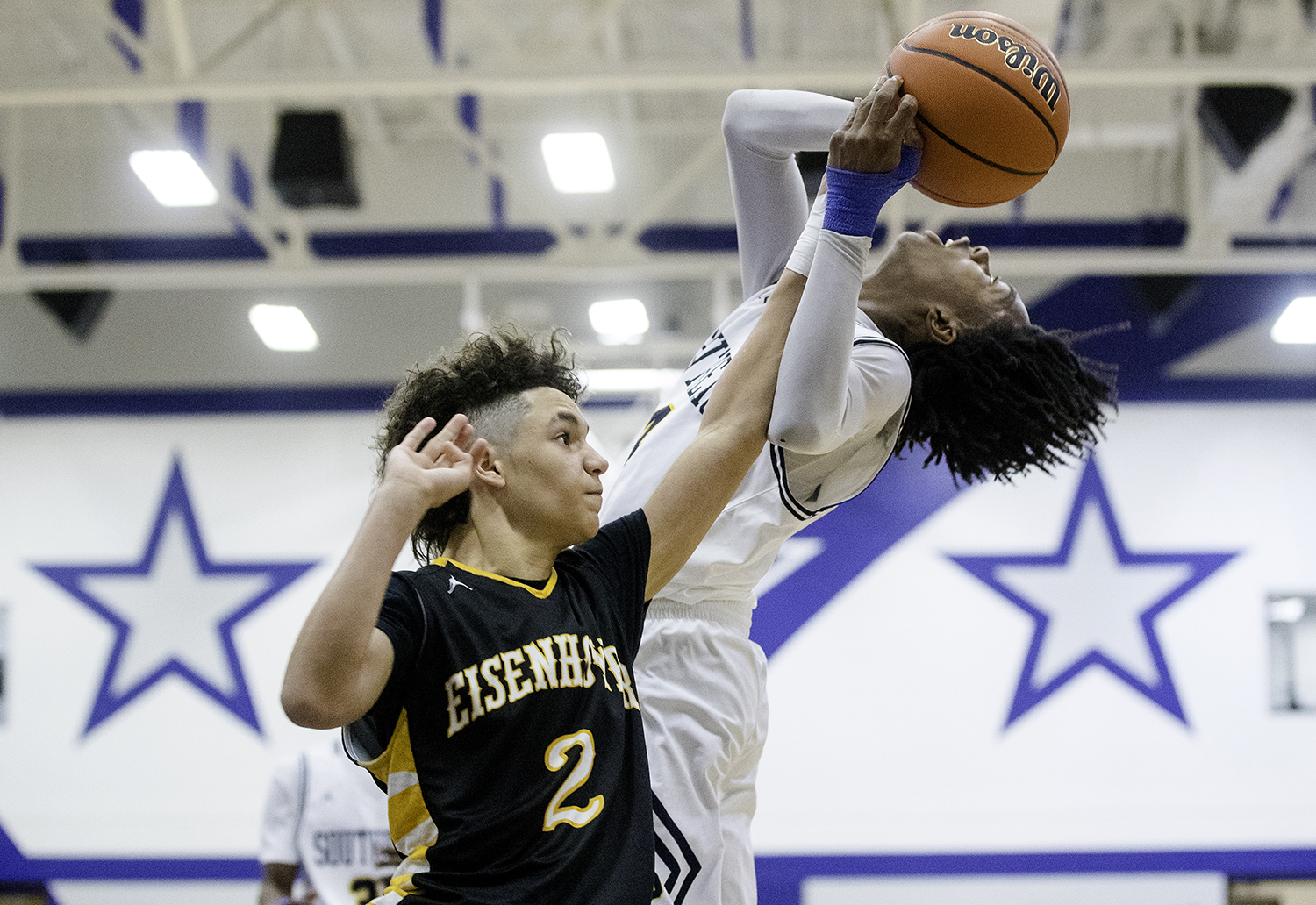 Eisenhower's Cameron Rowe fouls Southeast's Terrion Murdix during the MacArthur 3A Regional Wednesday, Feb. 27, 2018. [Ted Schurter/The State Journal-Register]