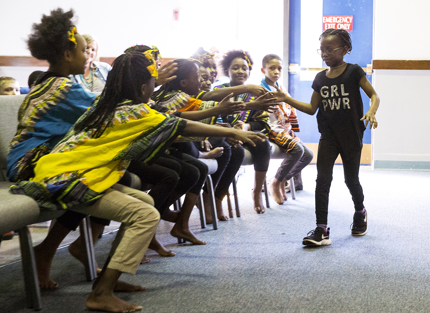 Fourth grader Allanah Lowery is congratulated by other students after her solo dance performance during the Black History Month Variety Show at Feitshans Elementary Tuesday, Feb. 27, 2018  in Springfield, Ill. [Rich Saal/The State Journal-Register]