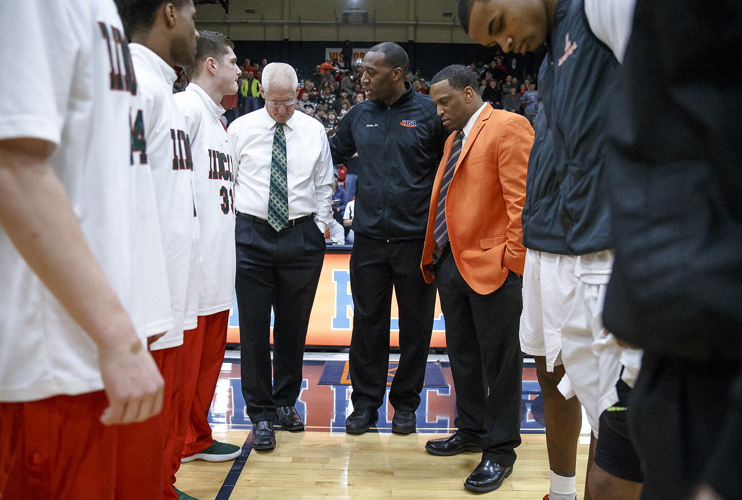Lincoln boys basketball head coach Neil Alexander, left, and Lanphier boys basketball head coach Blake Turner, right, meet with the captains and referees prior to the first half of the Class 3A Rochester Regional title game at the Rochester Athletic Complex, Friday, March 2, 2018, in Rochester, Ill. [Justin L. Fowler/The State Journal-Register]