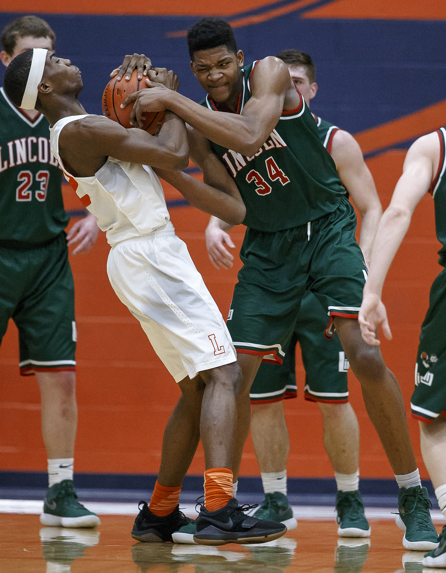 Lanphier's Karl Wright (32) fights for a rebound against Lincoln's Jermaine Hamlin (34) in the first half of the Class 3A Rochester Regional title game at the Rochester Athletic Complex, Friday, March 2, 2018, in Rochester, Ill. [Justin L. Fowler/The State Journal-Register]