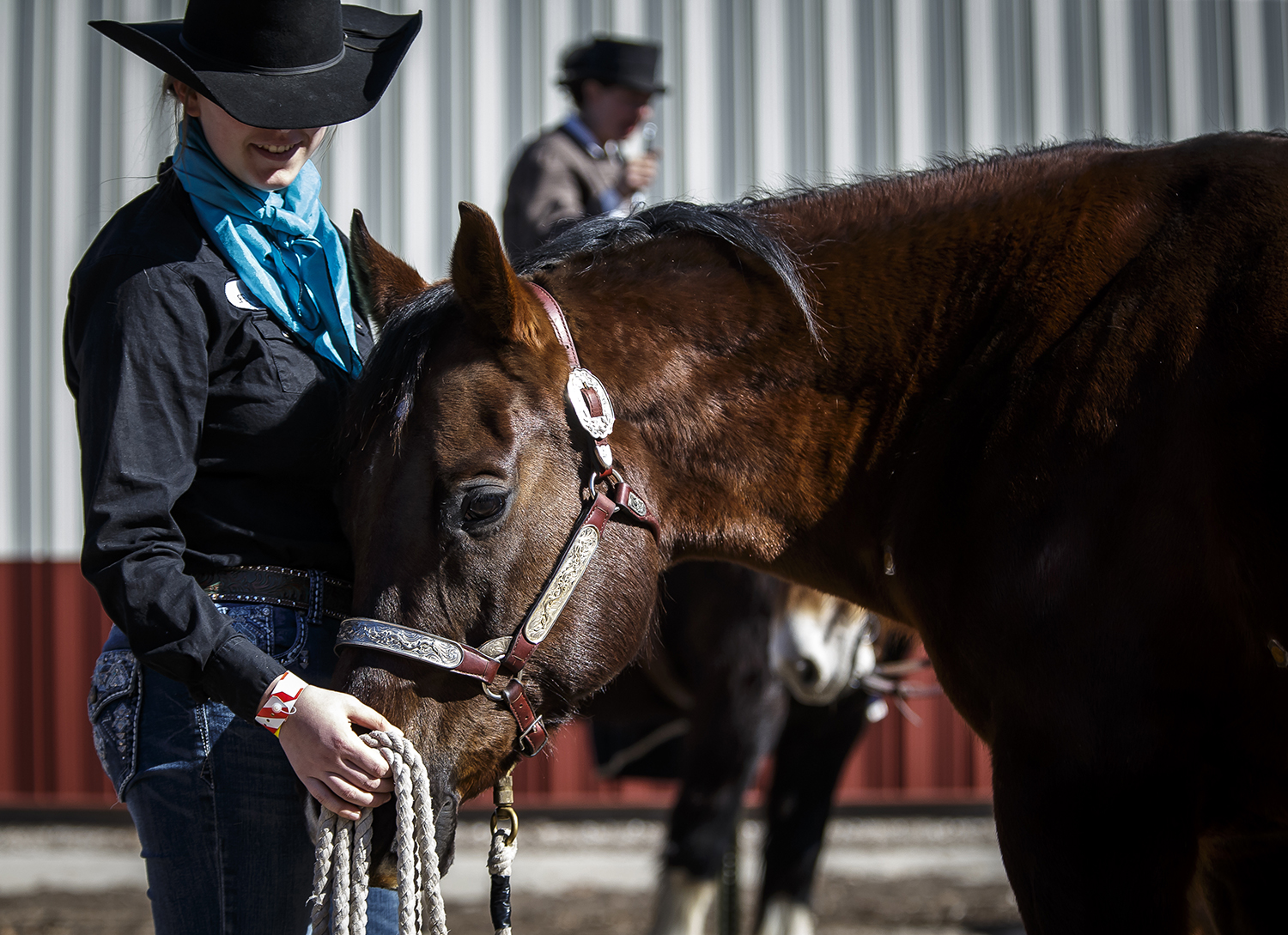 Taylor Warren, of Matoon, Ill., gives Freckles, an American quarter horse, a nose rub while they help show the AculIfe Patches used for safe and natural pain relief and quality of life for horses during the 2018 Illinois Horse Fair at the Illinois State Fairgrounds, Saturday, March 3, 2018, in Springfield, Ill. [Justin L. Fowler/The State Journal-Register]