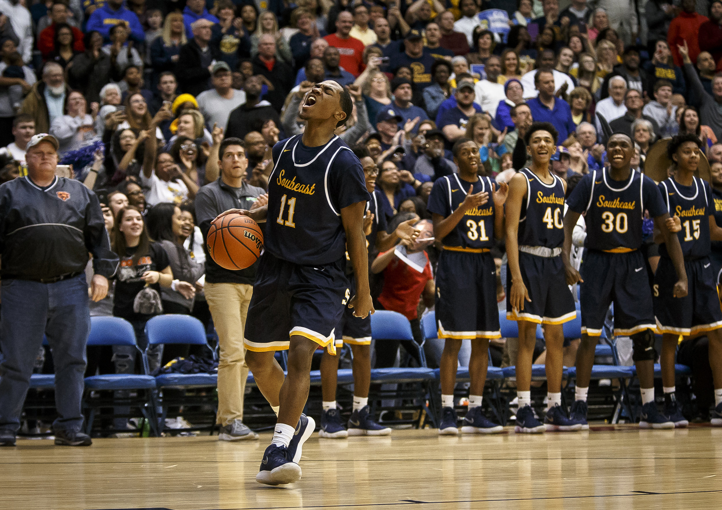 Southeast's Kobe Medley (11) screams out as the Spartans defeat Marion 56-51 in the Class 3A Springfield Supersectional at the Bank of Springfield Center, Tuesday, March 13, 2018, in Springfield, Ill. [Justin L. Fowler/The State Journal-Register]