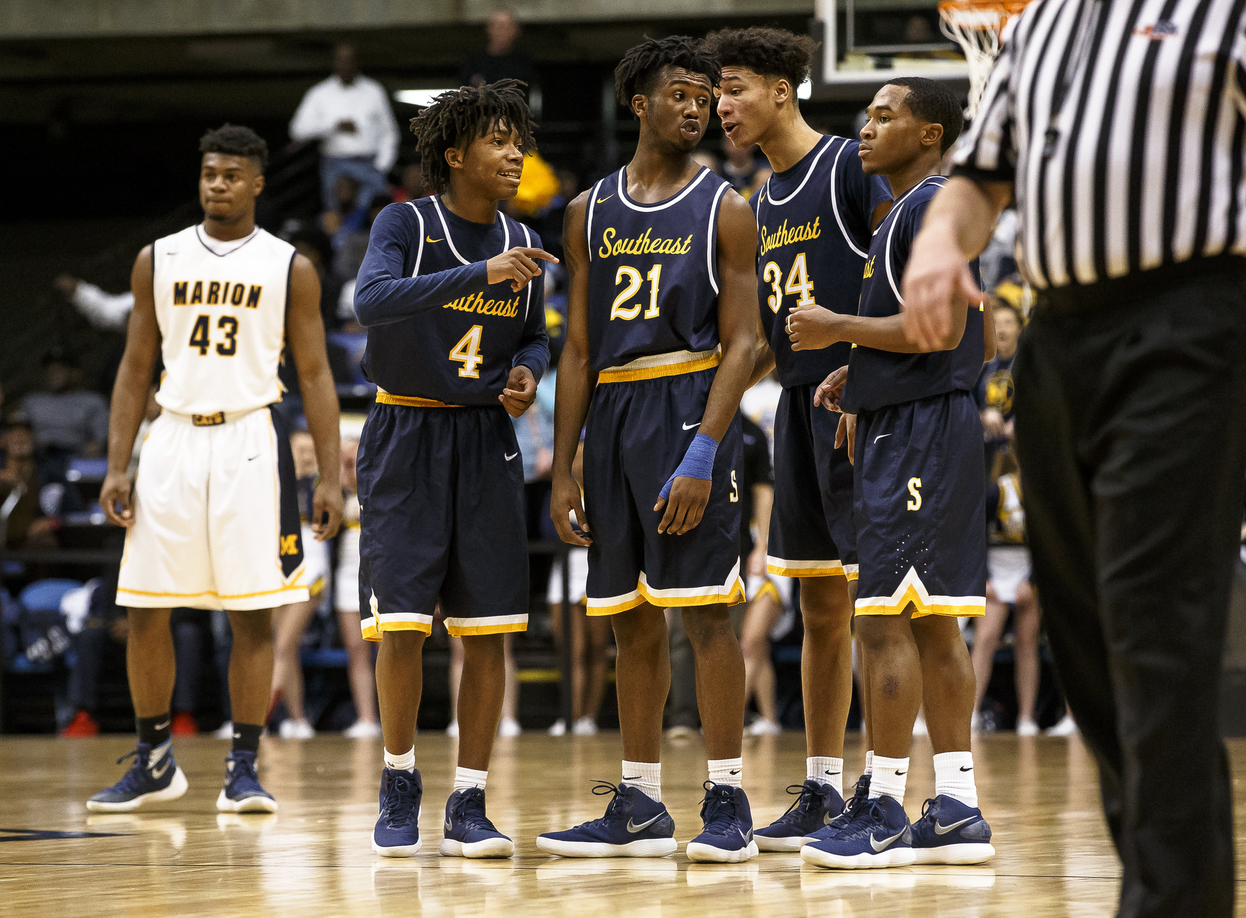 Southeast's Anthony Fairlee (21) and the Spartans huddle together after an intentional foul call against Marion in the second half during the Class 3A Springfield Supersectional at the Bank of Springfield Center, Tuesday, March 13, 2018, in Springfield, Ill. [Justin L. Fowler/The State Journal-Register]