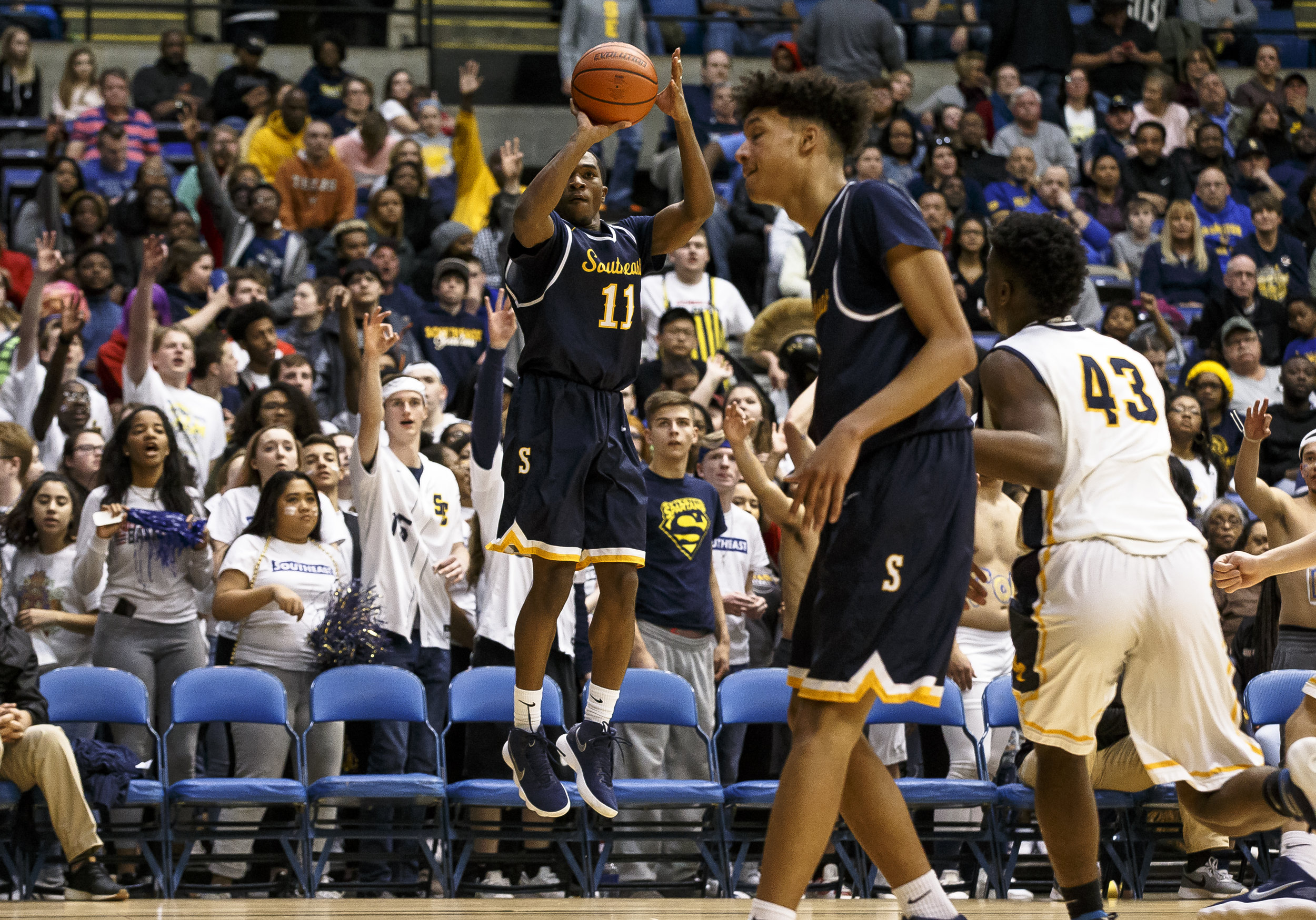 Southeast's Kobe Medley (11) shoots a 3-pointer against Marion in the second half during the Class 3A Springfield Supersectional at the Bank of Springfield Center, Tuesday, March 13, 2018, in Springfield, Ill. [Justin L. Fowler/The State Journal-Register]