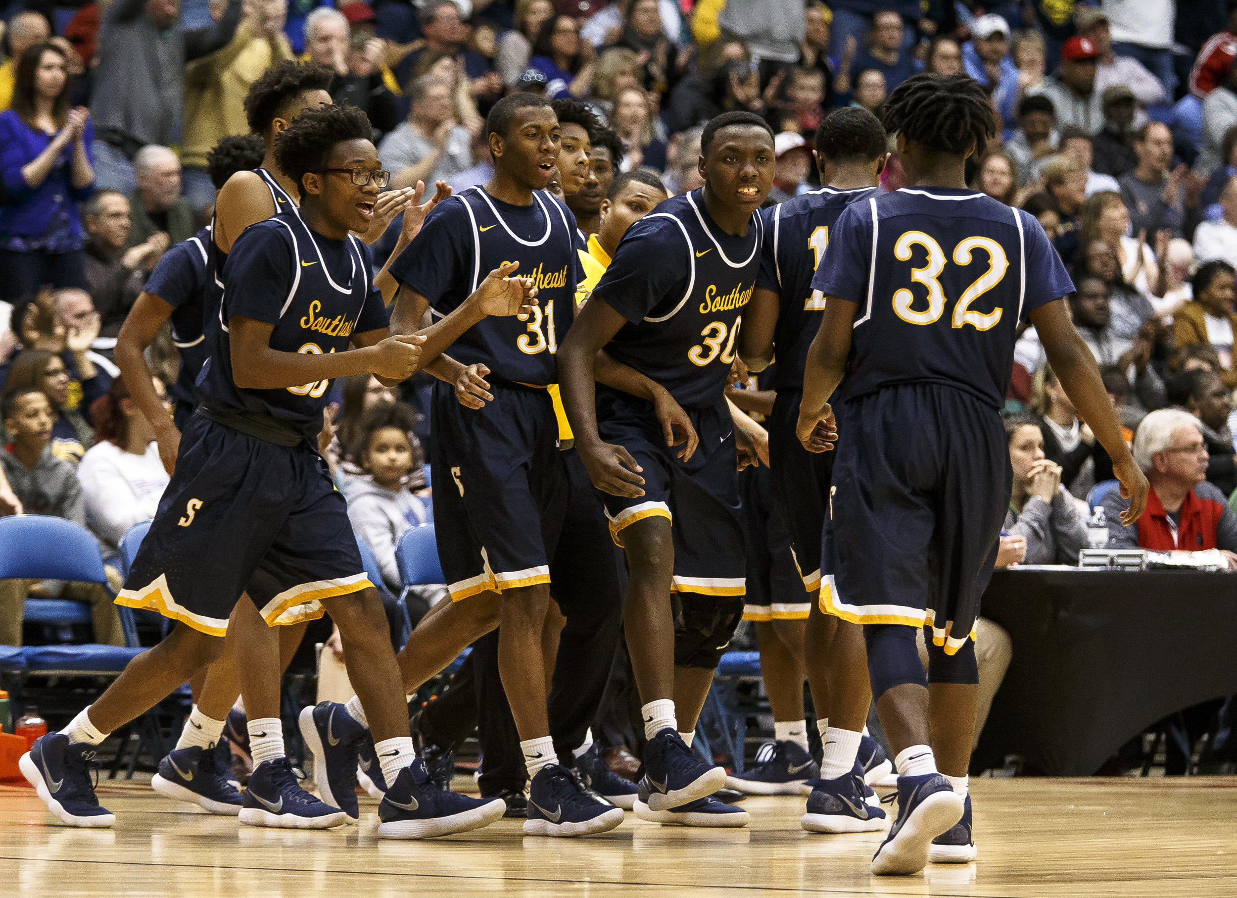 The Southeast bench congratulates Southeast's Stepheon Sims (32) after a basket and a time out from Marion in the second half during the Class 3A Springfield Supersectional at the Bank of Springfield Center, Tuesday, March 13, 2018, in Springfield, Ill. [Justin L. Fowler/The State Journal-Register]