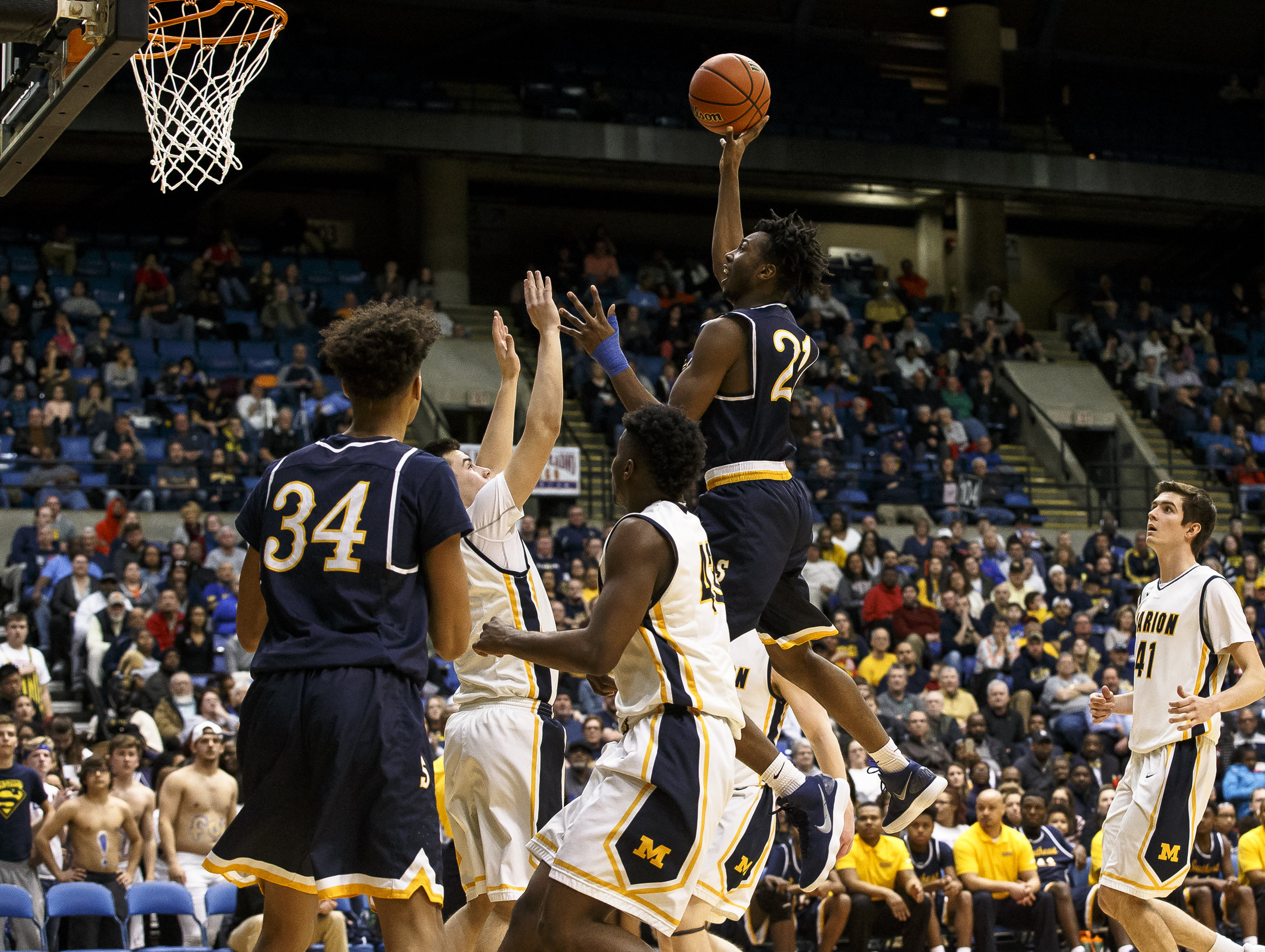Southeast's Anthony Fairlee (21) goes up and over Marion for a basket in the second half during the Class 3A Springfield Supersectional at the Bank of Springfield Center, Tuesday, March 13, 2018, in Springfield, Ill. [Justin L. Fowler/The State Journal-Register]