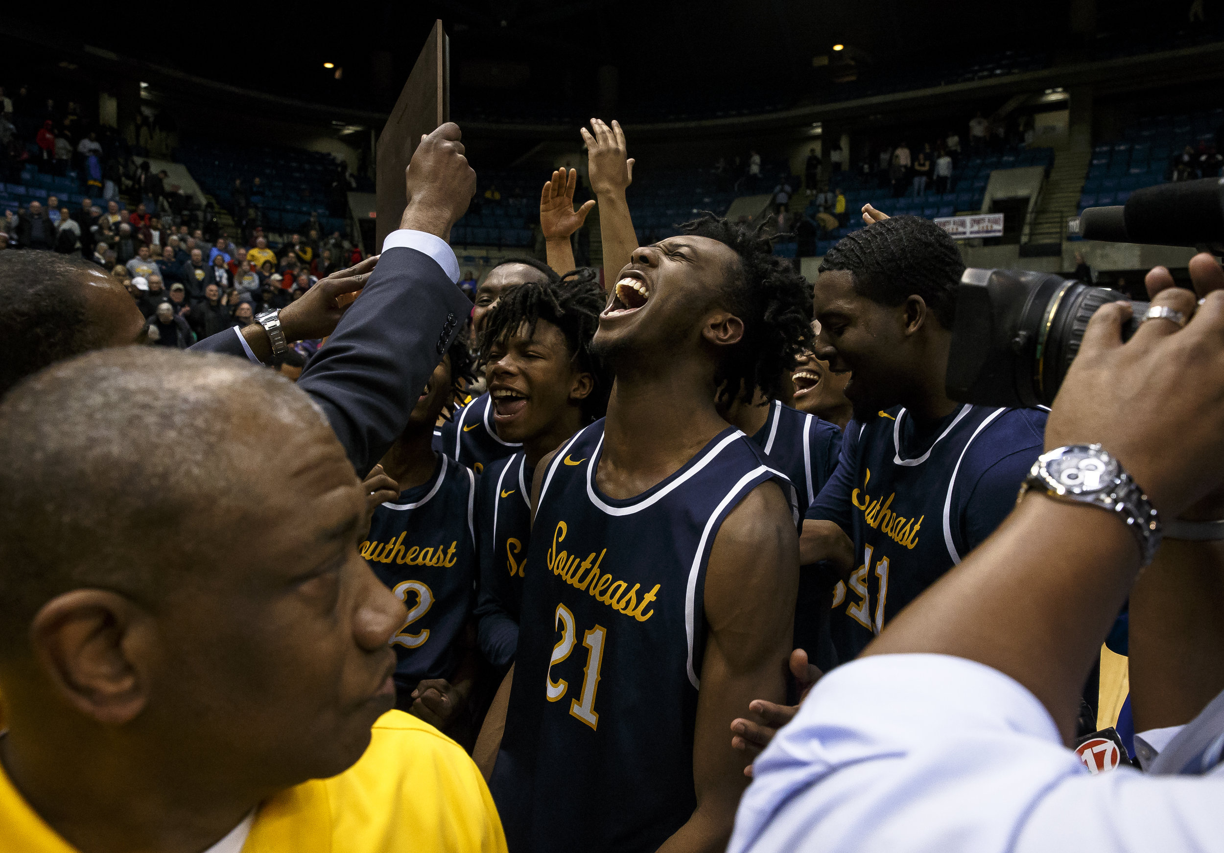 Southeast's Anthony Fairlee (21) screams out as the Spartans accept their championship plaque after their 56-51 victory over Marion in the Class 3A Springfield Supersectional at the Bank of Springfield Center, Tuesday, March 13, 2018, in Springfield, Ill. [Justin L. Fowler/The State Journal-Register]