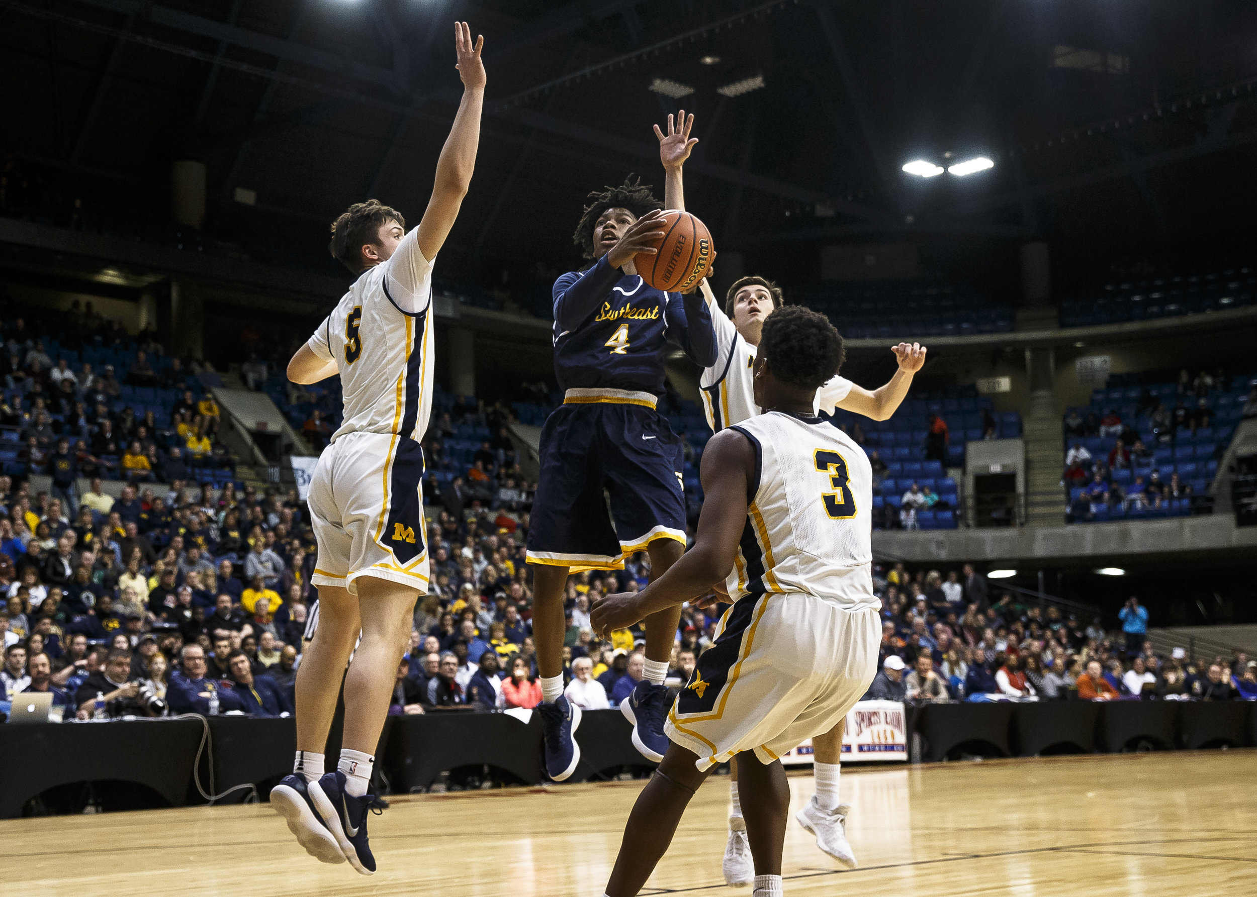 Southeast's Terrion Murdix (4) draws the triple team as he drives up to the basket against Marion in the first half during the Class 3A Springfield Supersectional at the Bank of Springfield Center, Tuesday, March 13, 2018, in Springfield, Ill. [Justin L. Fowler/The State Journal-Register]
