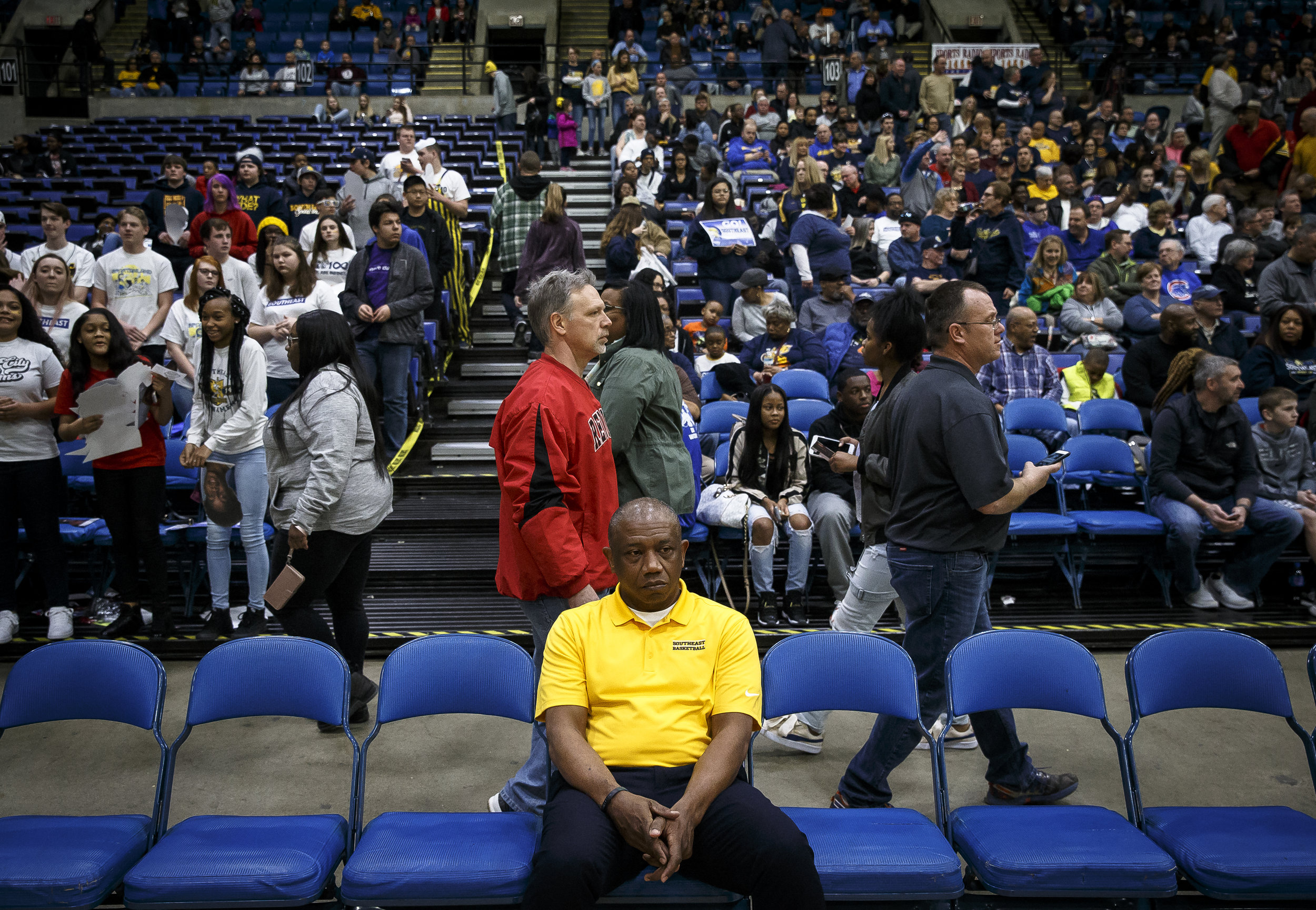 Southeast boys basketball head coach Lawrence Thomas watches from the bench as the Spartans get set to take on Marion in the Class 3A Springfield Supersectional at the Bank of Springfield Center, Tuesday, March 13, 2018, in Springfield, Ill. [Justin L. Fowler/The State Journal-Register]