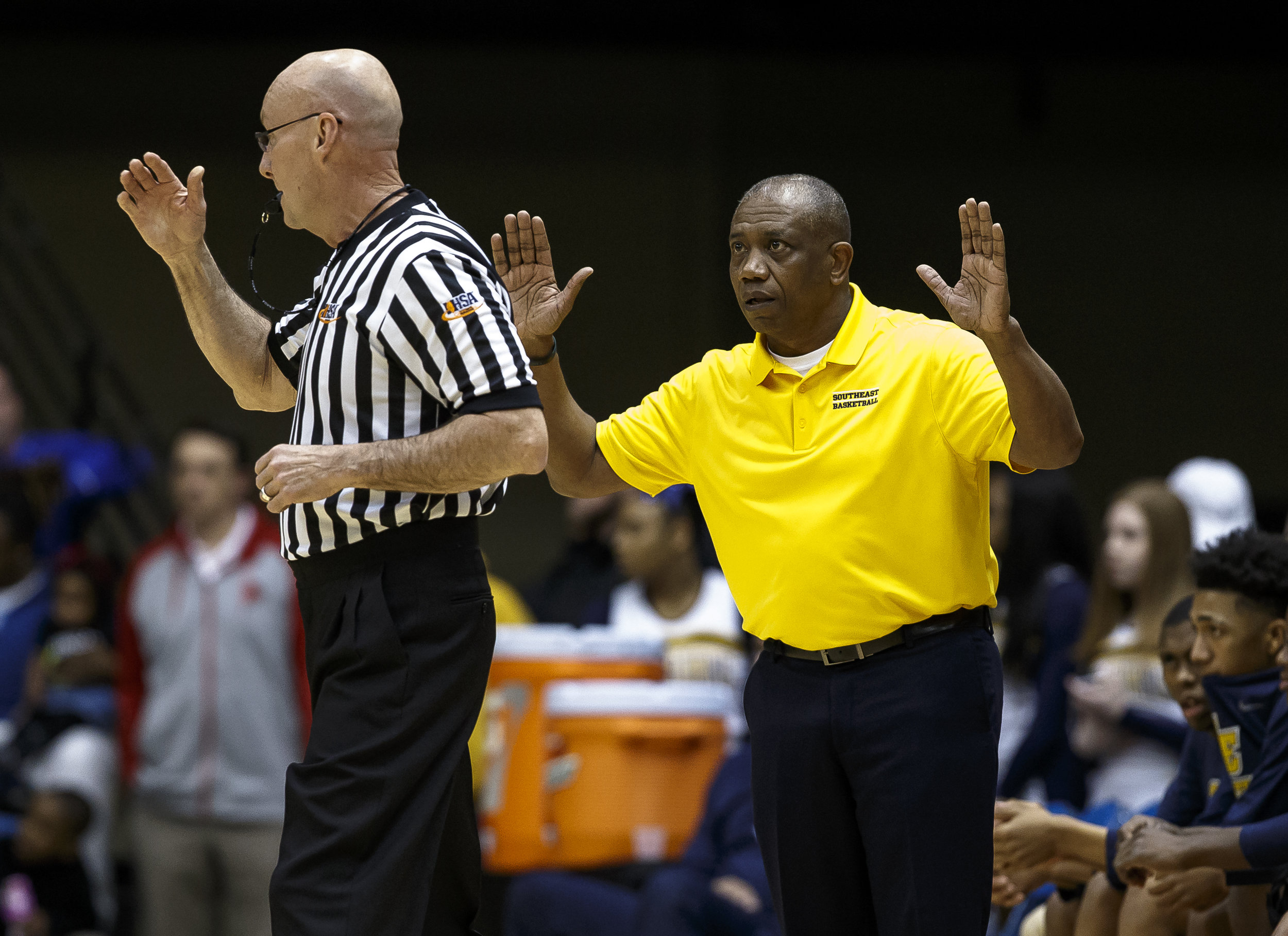 Southeast boys basketball head coach Lawrence Thomas argues against a foul call on the Spartans as they take on Marion in the first half during the Class 3A Springfield Supersectional at the Bank of Springfield Center, Tuesday, March 13, 2018, in Springfield, Ill. [Justin L. Fowler/The State Journal-Register]