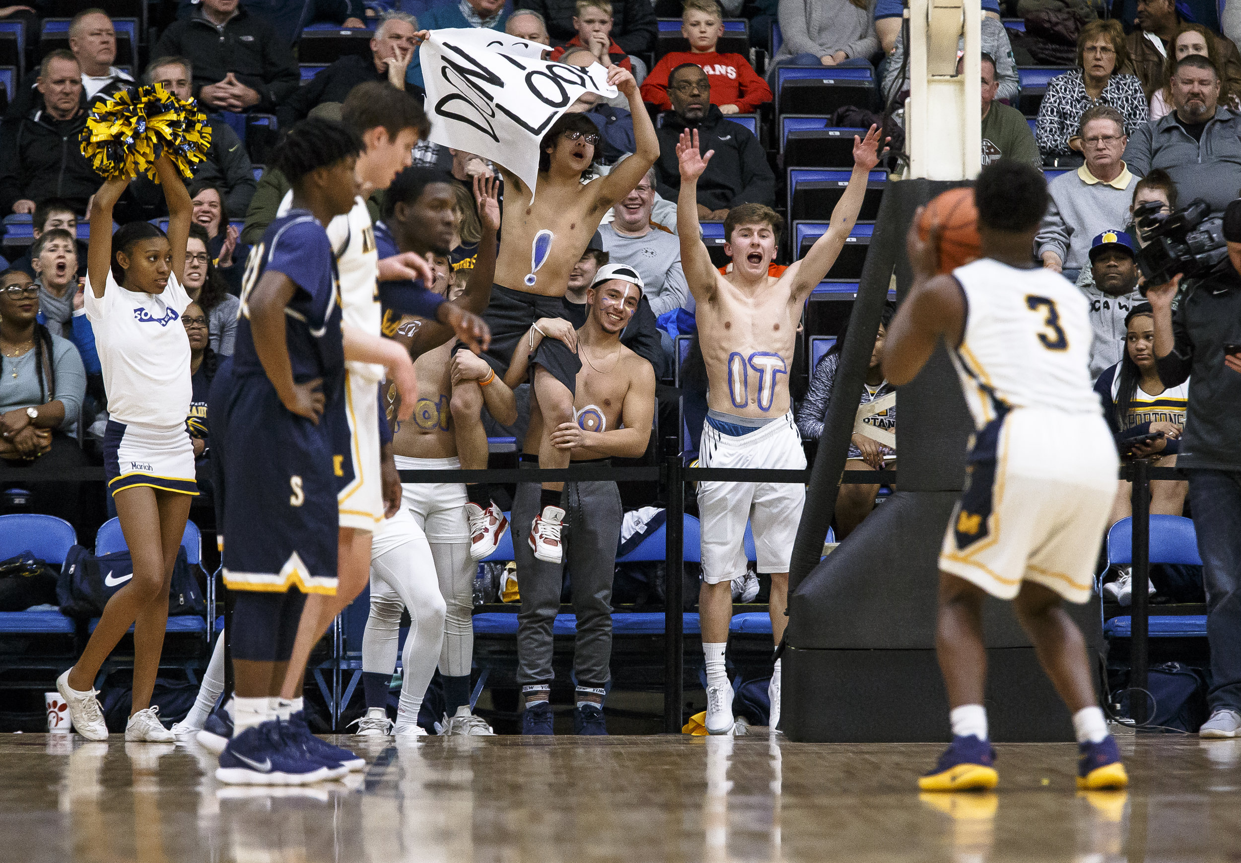 Southeast fans do their best to distract Marion's Jaden Lacy (3) as he shoots free throws in the first half during the Class 3A Springfield Supersectional at the Bank of Springfield Center, Tuesday, March 13, 2018, in Springfield, Ill. [Justin L. Fowler/The State Journal-Register]