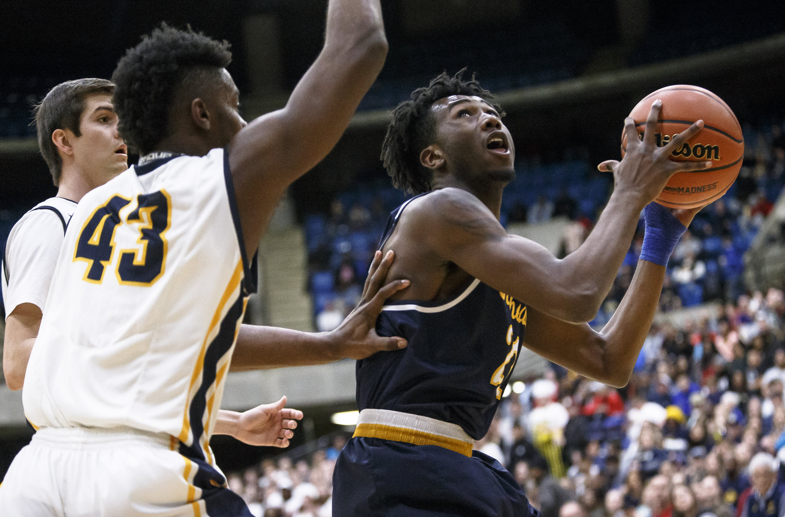 Southeast's Anthony Fairlee (21) goes up to the basket against Marion's Terrell Henderson (43) in the first half during the Class 3A Springfield Supersectional at the Bank of Springfield Center, Tuesday, March 13, 2018, in Springfield, Ill. [Justin L. Fowler/The State Journal-Register]