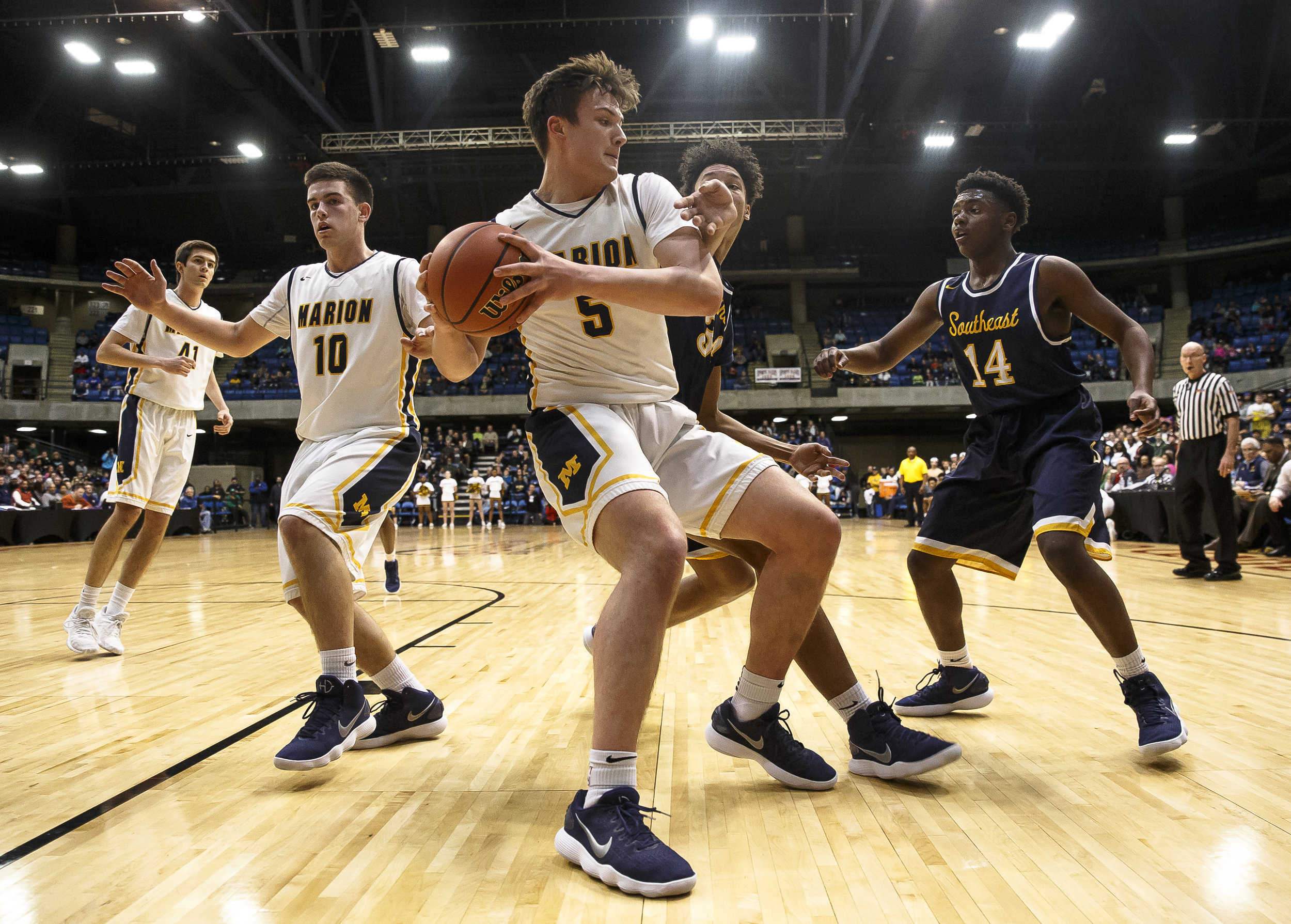 Marion's Jackson Connor (5) pulls in a rebound against Southeast's Michael Tyler (34) in the first half during the Class 3A Springfield Supersectional at the Bank of Springfield Center, Tuesday, March 13, 2018, in Springfield, Ill. [Justin L. Fowler/The State Journal-Register]