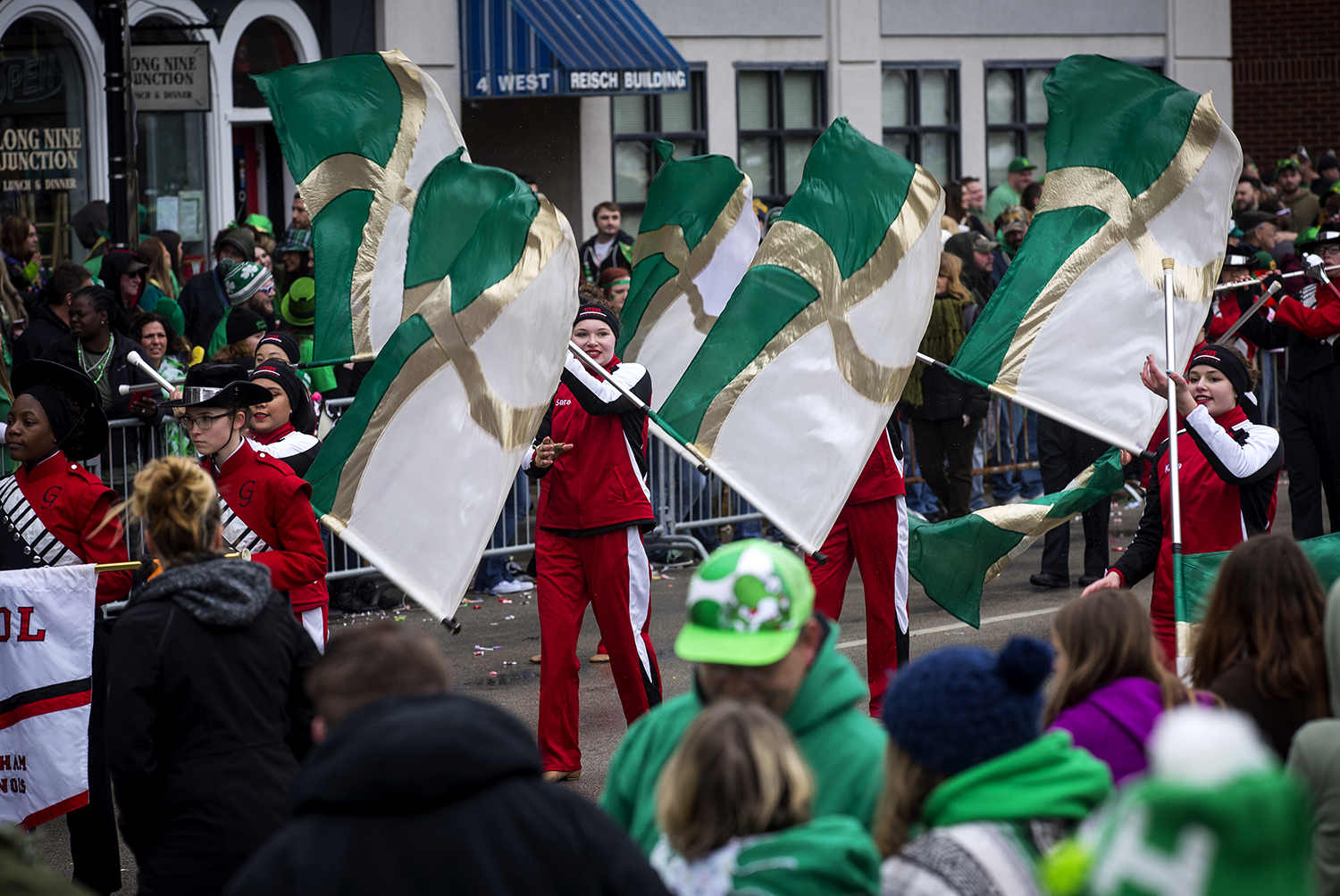 The Glenwood High School marching band flag team walks down Fifth Street during the St. Patrick's Day Parade Saturday, March 17, 2018  in Springfield, Ill. [Rich Saal/The State Journal-Register]