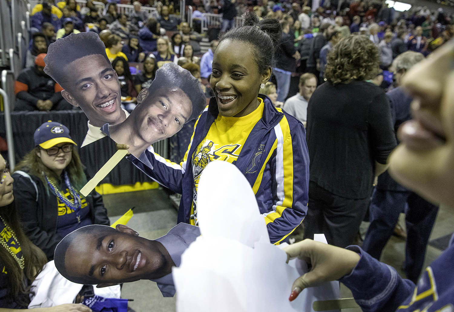Southeast senior Leah Tiner hands out signs featuring Spartan players before the team takes the floor against Chicago Morgan Park during the 3A championship game at Carver Arena in Peoria, Ill., Saturday, March 17, 2018. [Ted Schurter/The State Journal-Register]