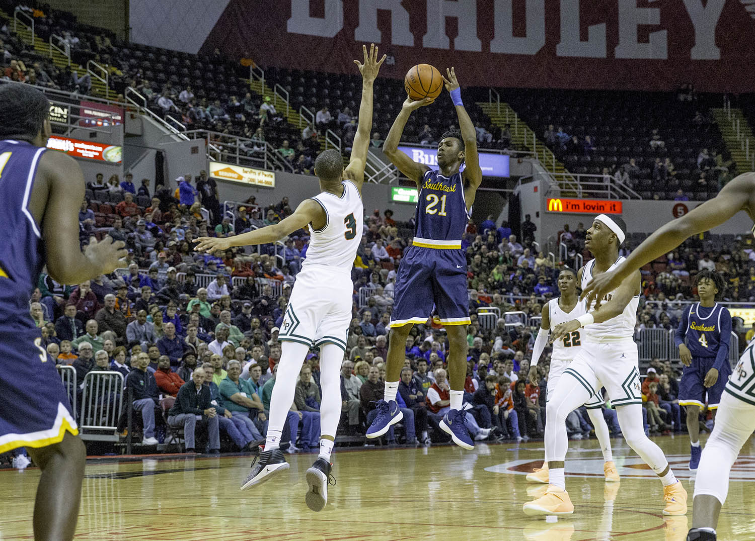 Southeast's Anthony Fairlee puts up a shot in front of Morgan Park's Cam Burrell during the 3A championship game at Carver Arena in Peoria, Ill., Saturday, March 17, 2018. [Ted Schurter/The State Journal-Register]