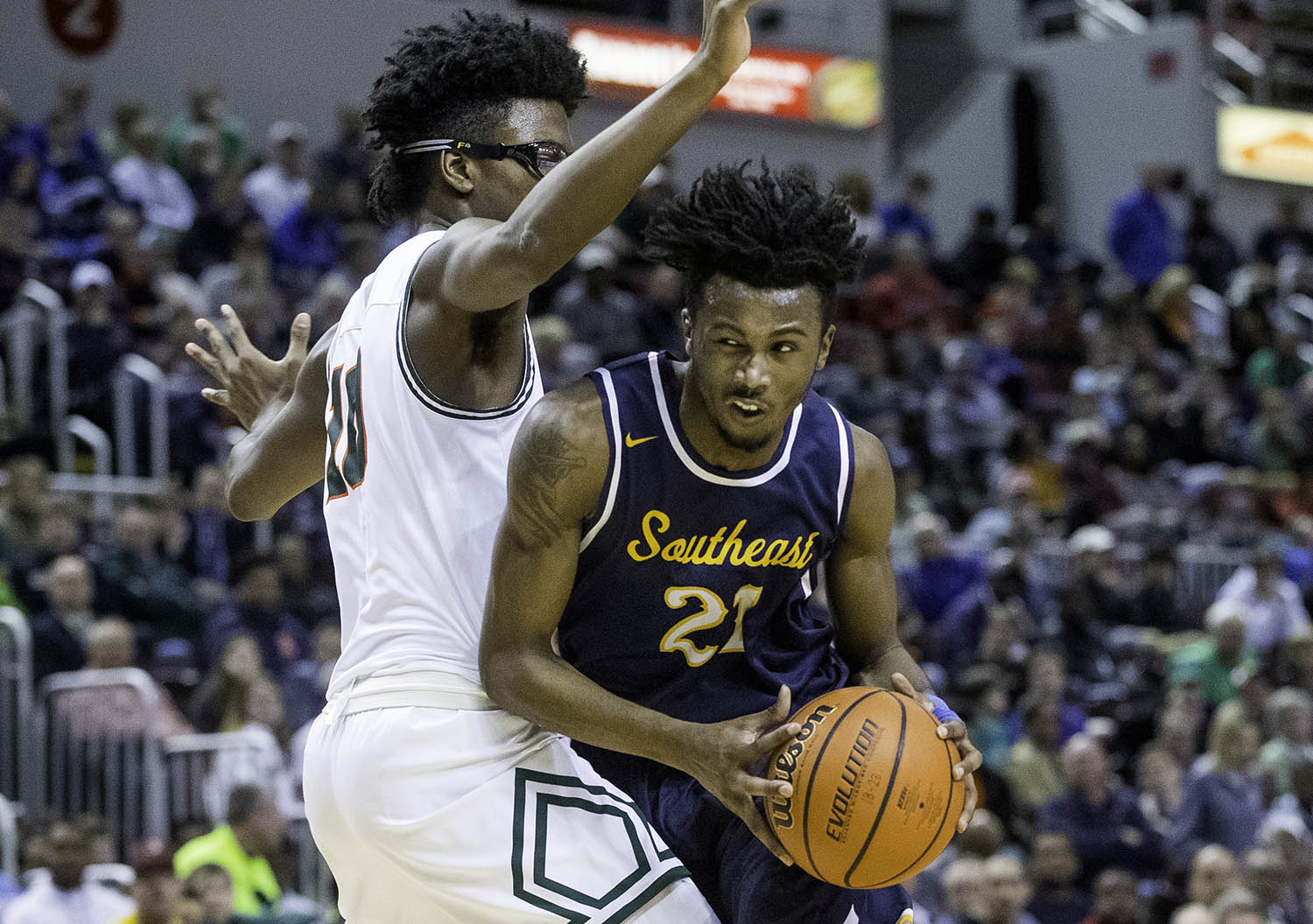 Southeast's Anthony Fairlee drives into Morgan Park's Tamell Pearson during the 3A championship game at Carver Arena in Peoria, Ill., Saturday, March 17, 2018. [Ted Schurter/The State Journal-Register]