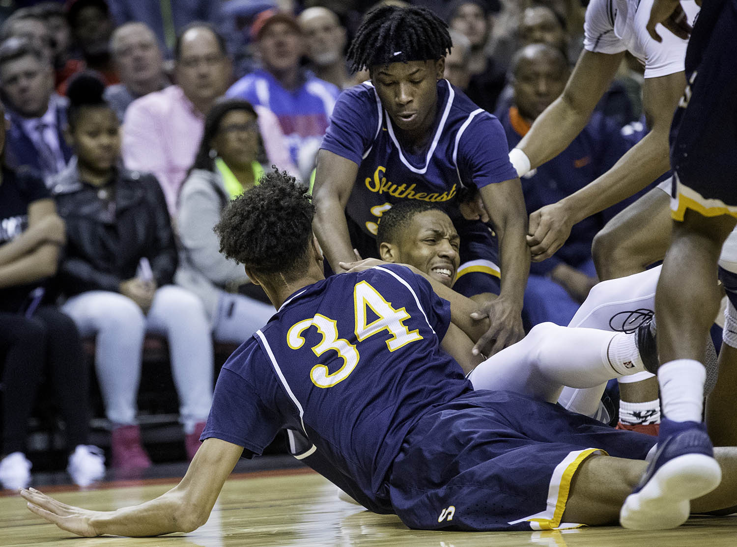 Southeast's Michael Tyler and Southeast's Stepheon Sims smother Morgan Park's Cam Burrell after he recovered a loose ball during the 3A championship game at Carver Arena in Peoria, Ill., Saturday, March 17, 2018. [Ted Schurter/The State Journal-Register]