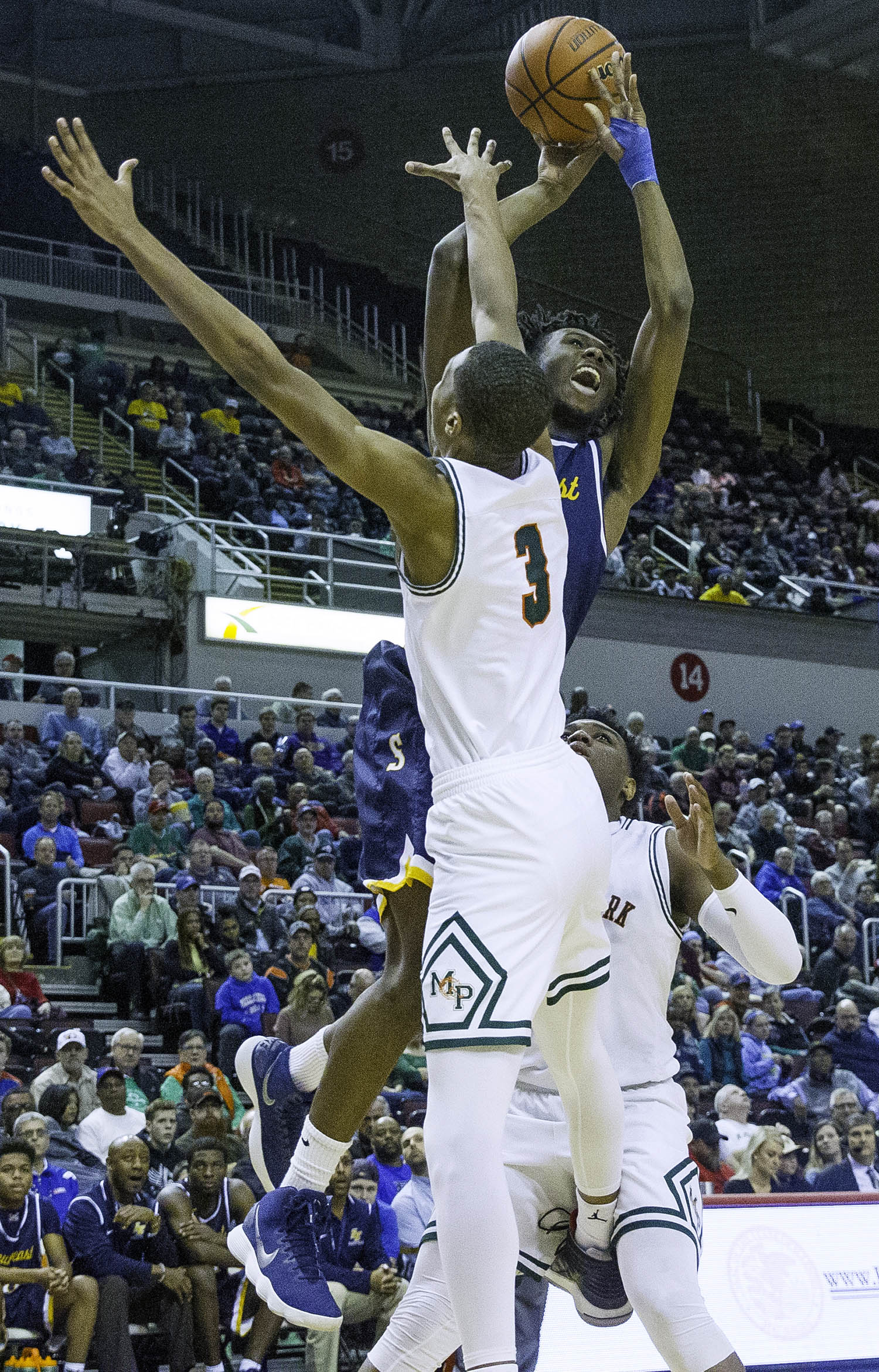 Southeast's Anthony Fairlee works a shot around Morgan Park's Cam Burrell  during the 3A championship game at Carver Arena in Peoria, Ill., Saturday, March 17, 2018. [Ted Schurter/The State Journal-Register]