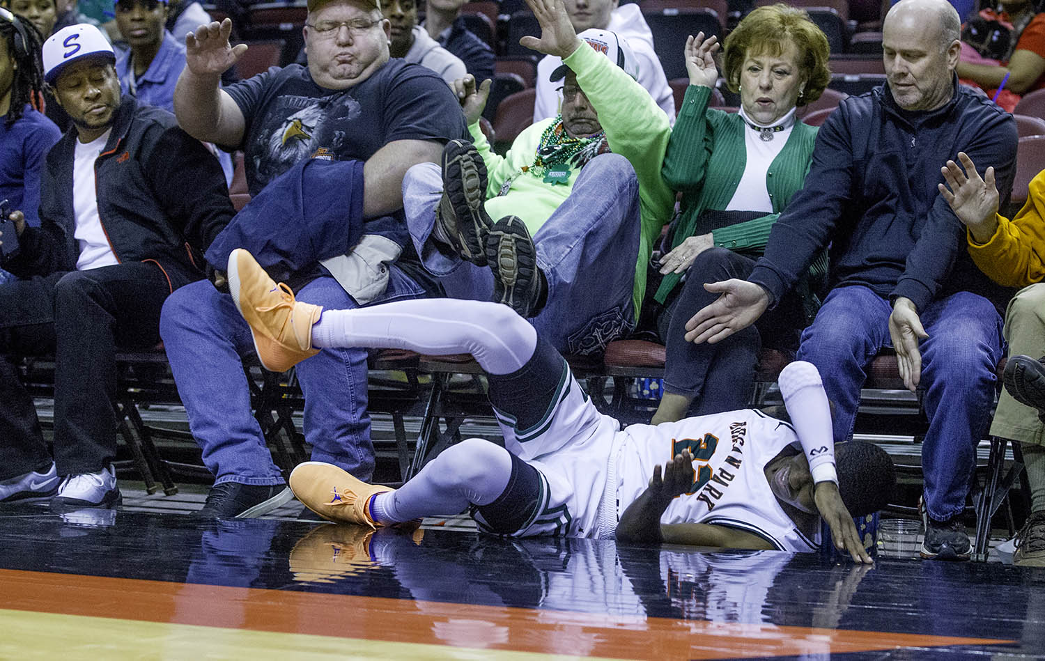 Morgan Park's Marcus Watson crashes out of bounds during the 3A championship game at Carver Arena in Peoria, Ill., Saturday, March 17, 2018. [Ted Schurter/The State Journal-Register]