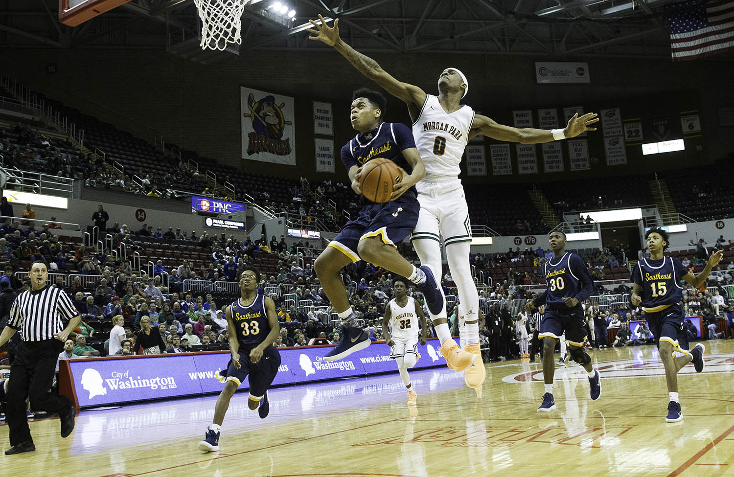 Southeast's Damon Davis drives to the hoop in front of Morgan Park's Kyel Grover during the 3A championship game at Carver Arena in Peoria, Ill., Saturday, March 17, 2018. [Ted Schurter/The State Journal-Register]