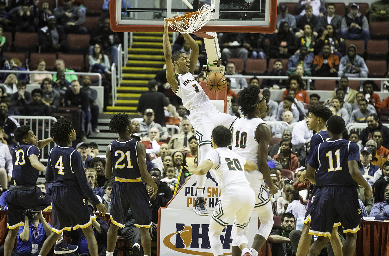 Morgan Park's Cam Burrell slams two points home against Southeast  during the 3A championship game at Carver Arena in Peoria, Ill., Saturday, March 17, 2018. [Ted Schurter/The State Journal-Register]