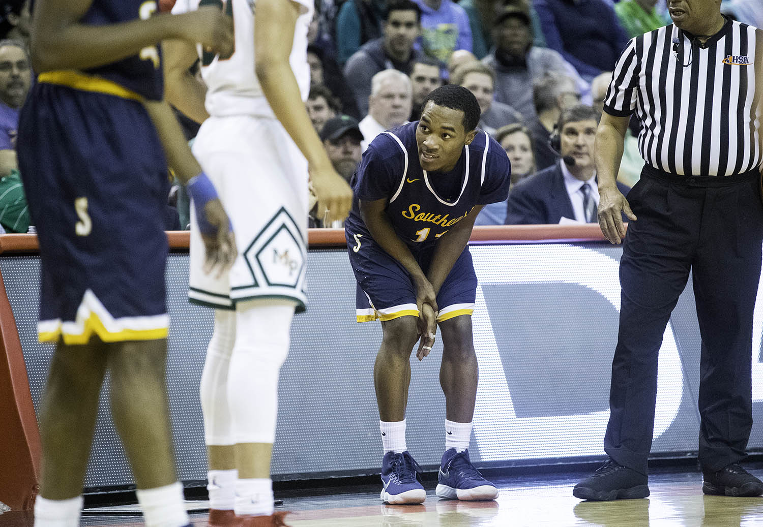 Southeast's Kobe Medley holds his hand after injuring it against Morgan Park  during the 3A championship game at Carver Arena in Peoria, Ill., Saturday, March 17, 2018. [Ted Schurter/The State Journal-Register]