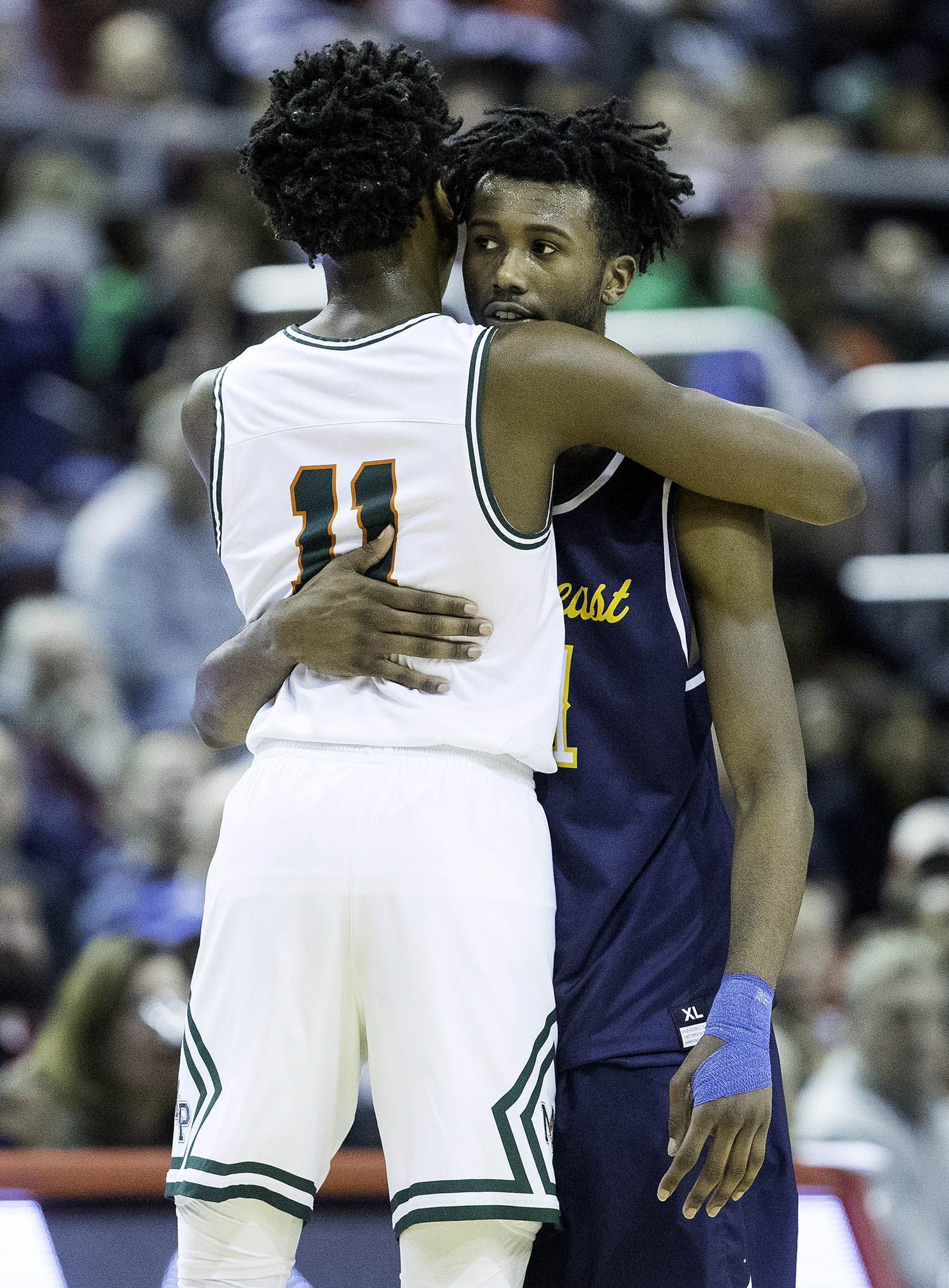 Morgan Park's Ayo Dosunmu hugs Southeast's Anthony Fairlee after Fairlee fouled out  during the 3A championship game at Carver Arena in Peoria, Ill., Saturday, March 17, 2018. [Ted Schurter/The State Journal-Register]