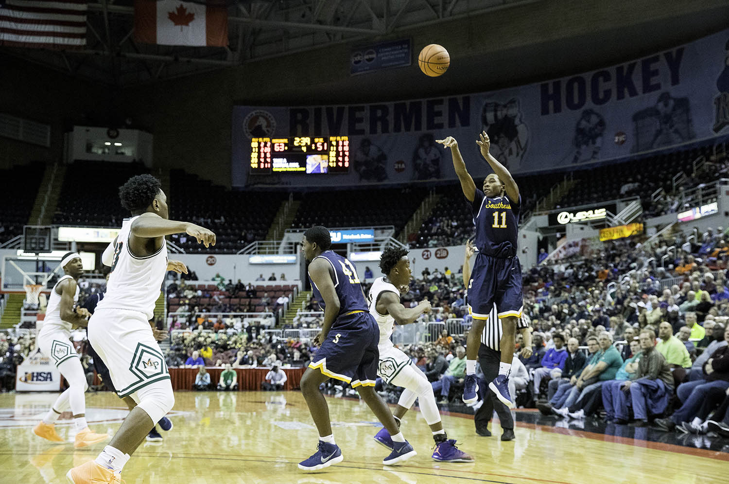 Southeast's Kobe Medley fires a three against Morgan Park  during the 3A championship game at Carver Arena in Peoria, Ill., Saturday, March 17, 2018. [Ted Schurter/The State Journal-Register]