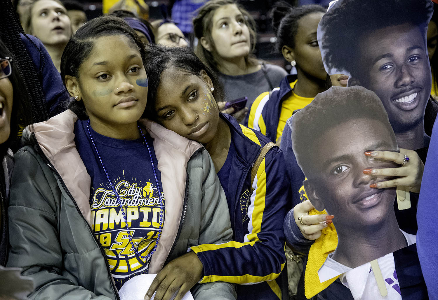 Southeast fans watch as the Spartans receive their medals after losing to Morgan Park  during the 3A championship game at Carver Arena in Peoria, Ill., Saturday, March 17, 2018. [Ted Schurter/The State Journal-Register]