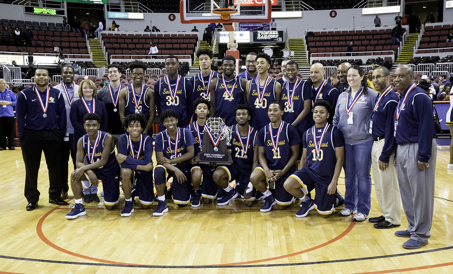 The Spartans pose with their runner-up trophy after falling to Morgan Park  during the 3A championship game at Carver Arena in Peoria, Ill., Saturday, March 17, 2018. [Ted Schurter/The State Journal-Register]