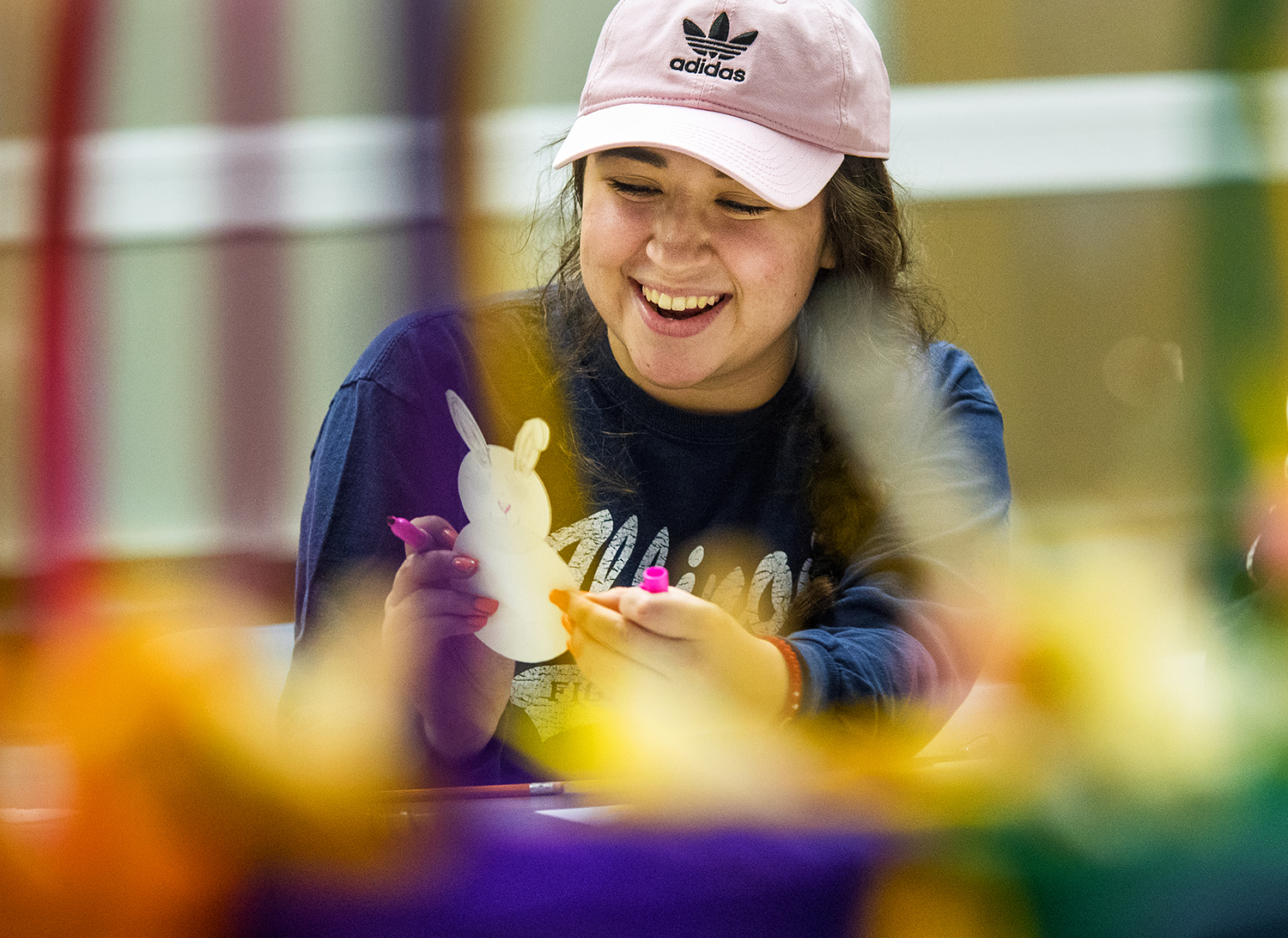 Karen Contreras laughs as she makes a bunny finger puppet at the Student Union at the University of Illinois Springfield Thursday, March 22, 2018. Contreras joined other students to cut, glue and decorate paper crafts to fill 40 Easter baskets. After candy is added, the baskets will be delivered for distribution to patients at HSHS St. John's Children's Hospital. [Ted Schurter/The State Journal-Register]