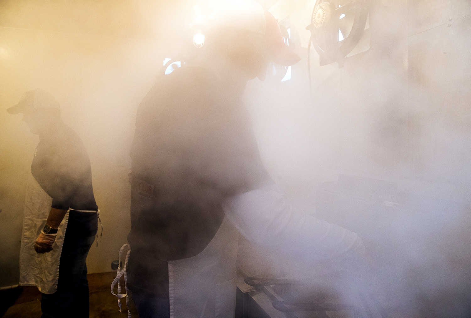 Andy Austwick is enveloped in steam as he cooks some of the 920 pounds of Pollock fish that will be sold at the Little Flower Men's Club 21st Annual Lenten Fish Fry Friday, March 23, 2018. Organizers said more than 1,000 meals are served between the dine-in and drive through during the event. [Ted Schurter/The State Journal-Register]