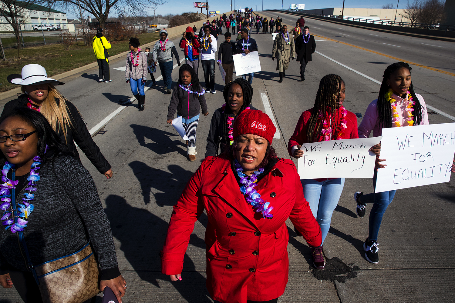 Sonya Perkins, center, sings as she participates in a reenactment of the historic 1965 Selma to Montgomery March on Sunday, March 25, 2018. The march, from Chamberlain Park to the Old State Capitol, was organized by the Sangamon County 4-H club. [Ted Schurter/The State Journal-Register]