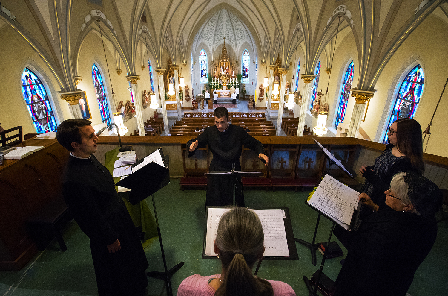 Brother Andrew Panzer directs the schola during the Latin Mass on Easter Sunday at Sacred Heart Church in Springfield, Ill., April 1, 2018. [Ted Schurter/The State Journal-Register]