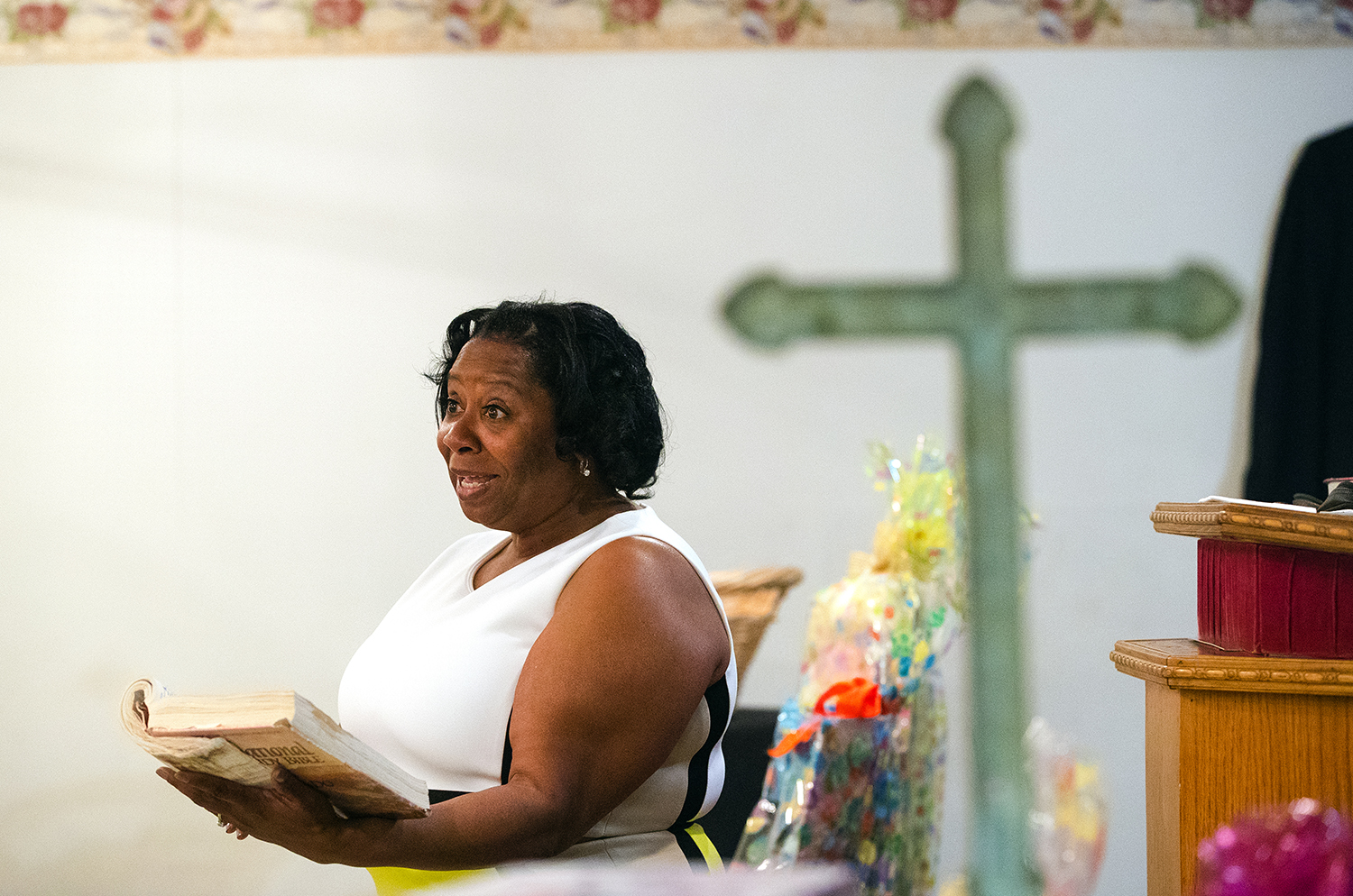 Debra Bell-Adetoro reads scripture during Easter service at City of Miracles International church in Springfield on Easter Sunday, April 1, 2018. [Ted Schurter/The State Journal-Register]