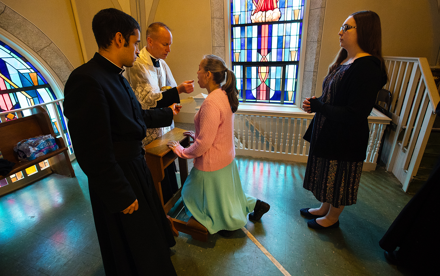 Betty Parquette receives The Eucharist from Pastor Fr. James Isaacson in the balcony of Sacred Heart Church during the Latin Mass on Easter Sunday April 1, 2018. [Ted Schurter/The State Journal-Register]