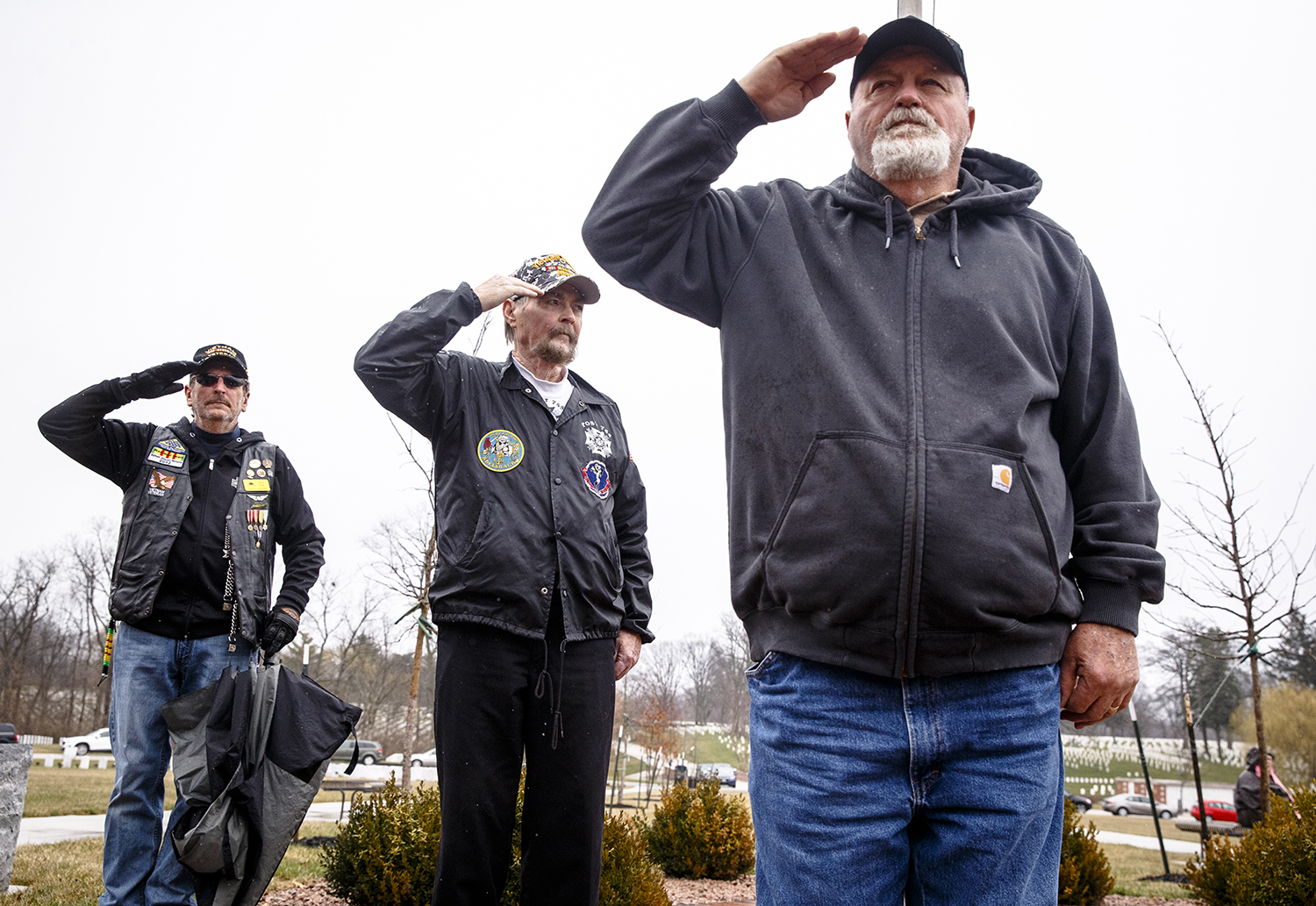 Vietnam veterans Steve Stout, left, Gene Walker, center, and Ben Beard, right, salute during the posting of the colors  for the Vietnam War Commemoration Ceremony at Camp Butler National Cemetery, Thursday, March 29, 2018, in Springfield, Ill. [Justin L. Fowler/The State Journal-Register]