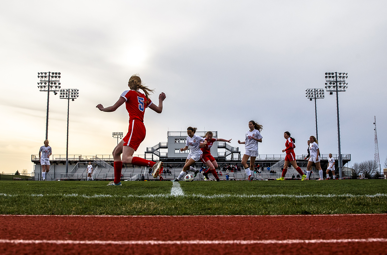 Clouds move in obscuring the sun as Pleasant Plains takes on Glenwood in the second half at Glenwood High School, Thursday, April 5, 2018, in Chatham, Ill. Athletic directors have been coping with several weeks of precipitation and cold that have postponed numerous sports events. [Justin L. Fowler/The State Journal-Register]