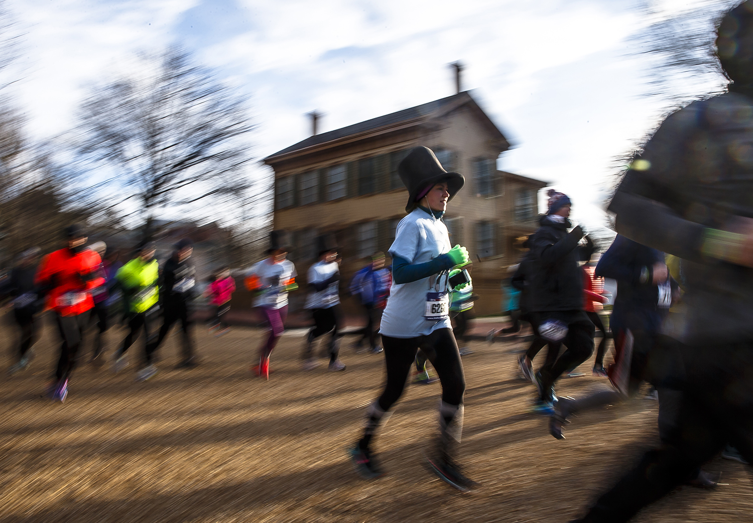 Runners make their way past the Lincoln Home during the 2018 Lincoln Presidential Half Marathon, Saturday, April 7, 2018, in Springfield, Ill. Around 1100 runners took part in the 13.1 mile race around historic landmarks in Springfield with temperatures in the 20s. [Justin L. Fowler/The State Journal-Register]