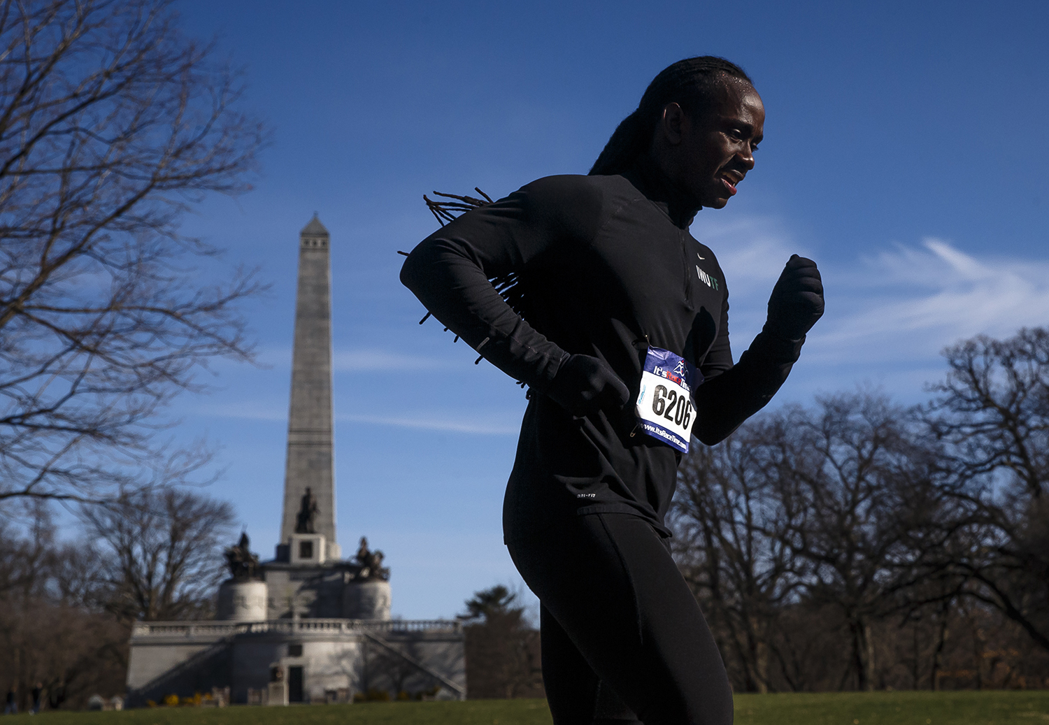 Jordan Collins passes by the Lincoln Tomb on his way out of Oak Ridge Cemetery during the 2018 Lincoln Presidential Half Marathon, Saturday, April 7, 2018, in Springfield, Ill. [Justin L. Fowler/The State Journal-Register]