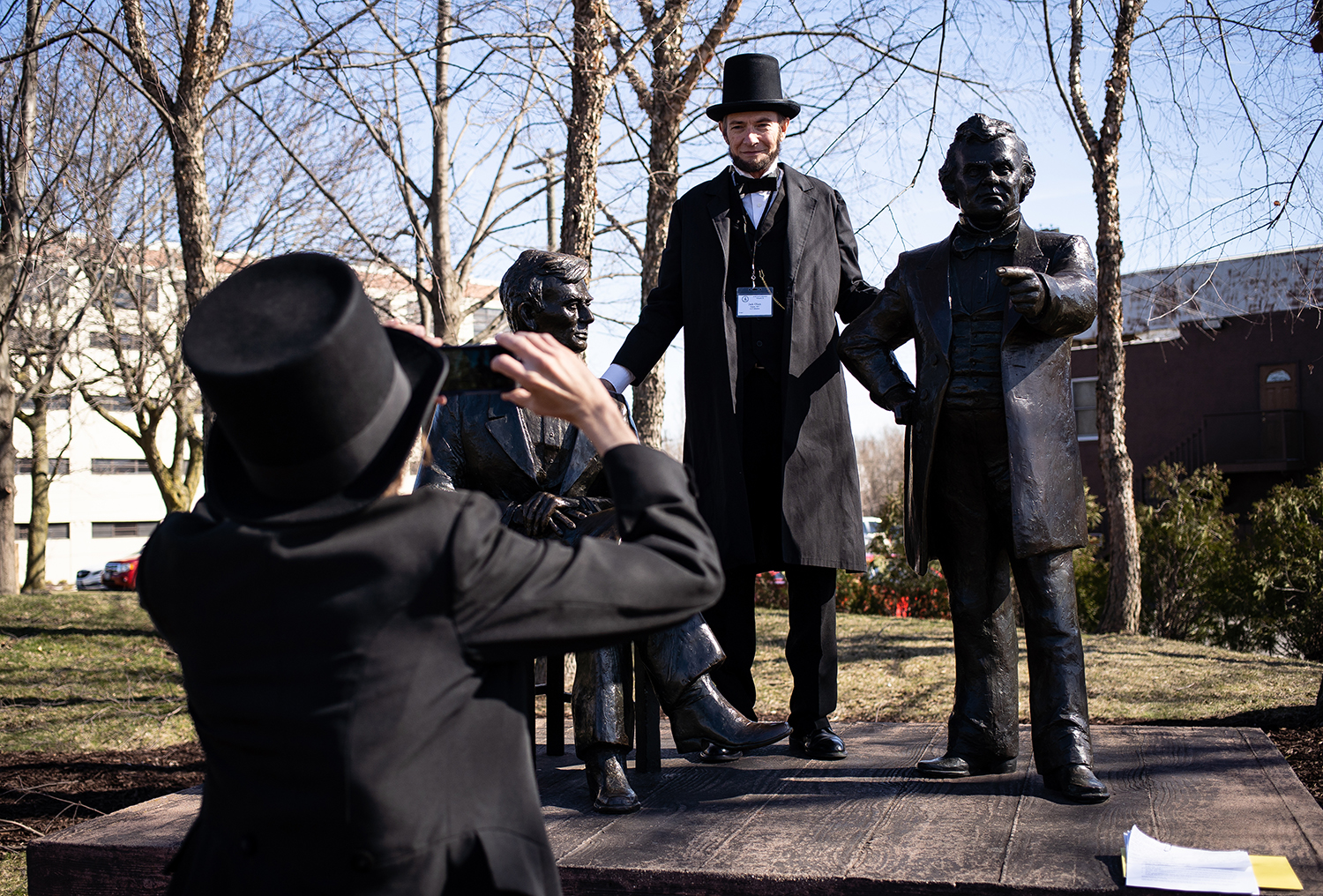 Danny Russell snaps a photo of Jack Olsen in Debate Square, the site of a Lincoln-Douglas debate in Freeport, Ill. during the Association of Lincoln Presenters annual convention Friday, April 20, 2018 in Freeport. [Rich Saal/The State Journal-Register]