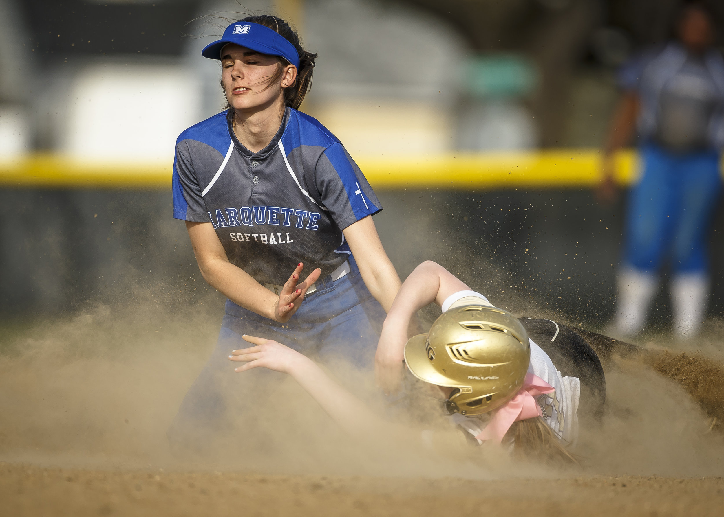 Alton Marquette's Hailey Johnson (9) tags out Sacred Heart-Griffin's Alivia Hemberger (12) at second base at SHG's West Campus, Thursday, April 12, 2018, in Springfield, Ill. [Justin L. Fowler/The State Journal-Register]
