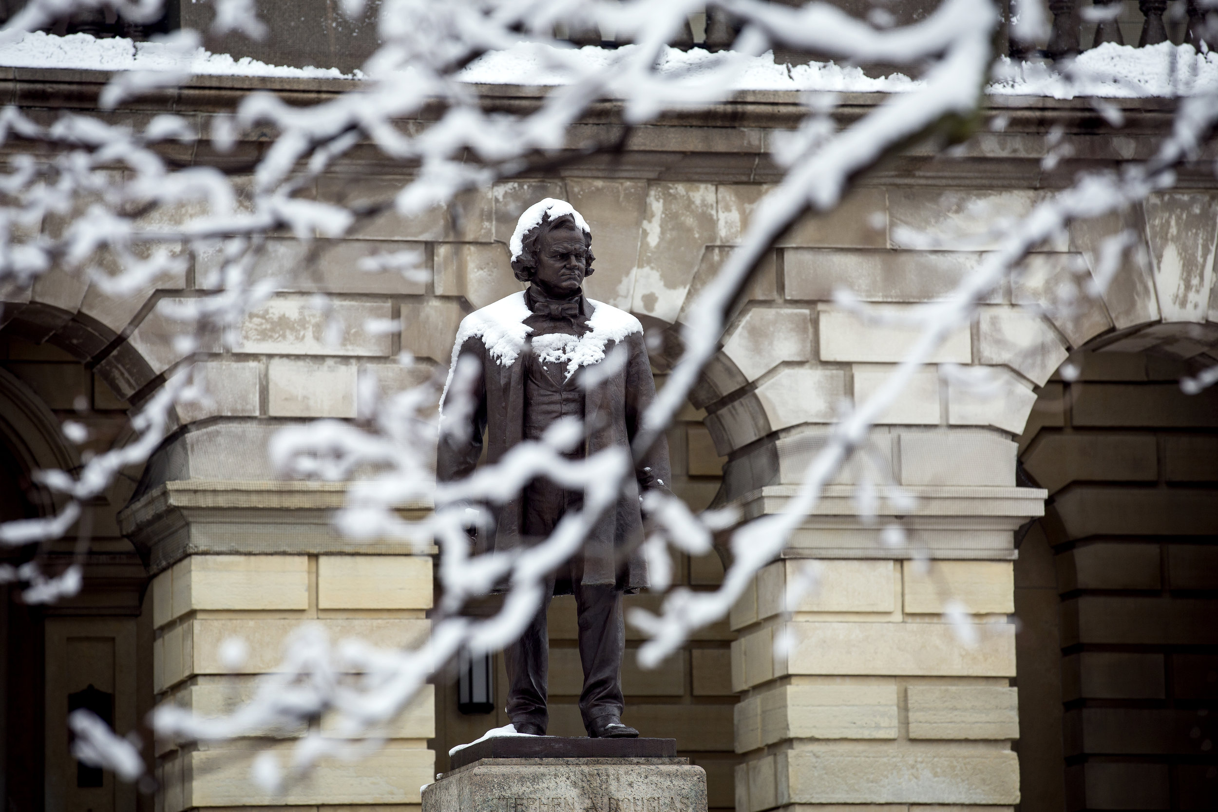 A statue of Stephen Douglas in front of the state Capitol is covered with snow after 2.5 inches fell overnight Monday, April 9, 2018  in Springfield, Ill. [Rich Saal/The State Journal-Register]