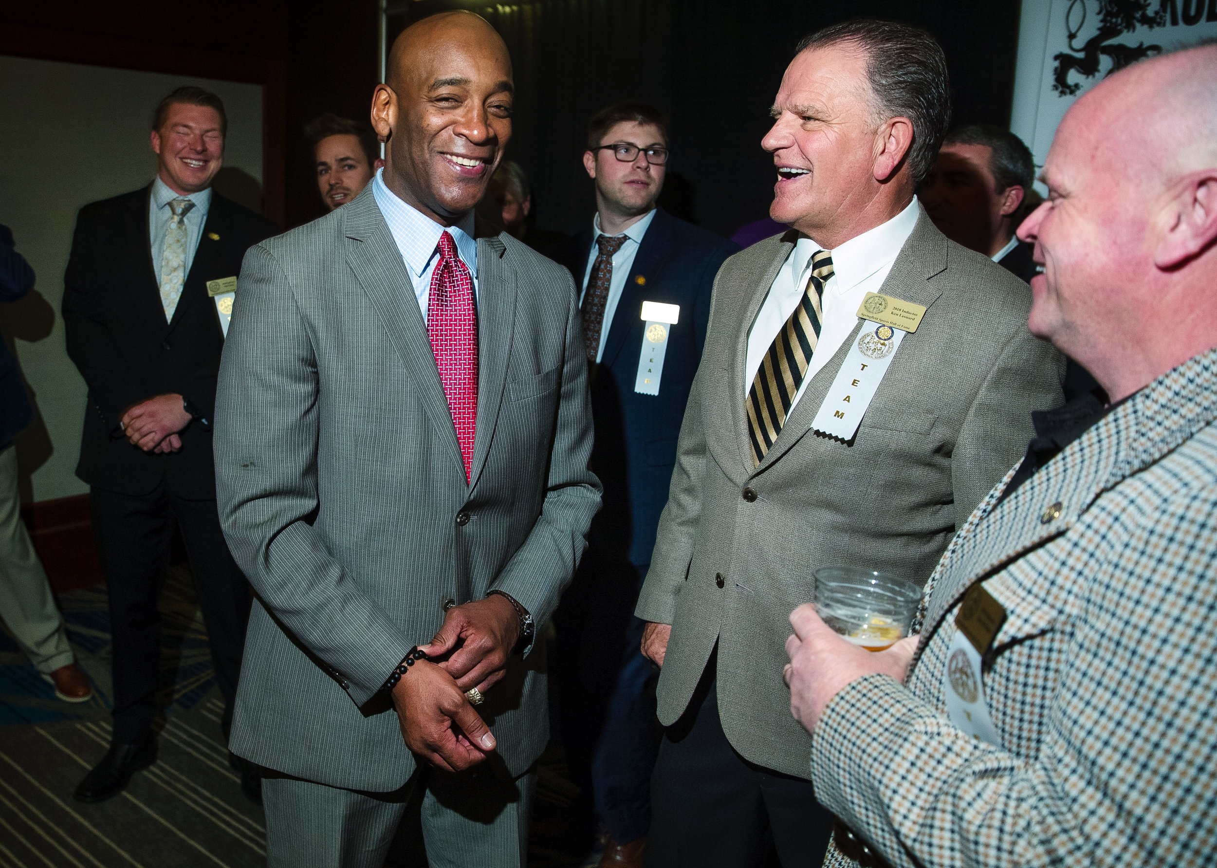 Former Notre Dame quarterback Tony Rice laughs with Sacred Heart-Griffin head football coach Ken Leonard and defensive coordinator Jim McMann before the ceremony at the Springfield Sports Hall of Fame banquet at the Crowne Plaza Monday, April 9, 2018. Rice lead the Fighting Irish to the 1988 national championship. [Ted Schurter/The State Journal-Register]