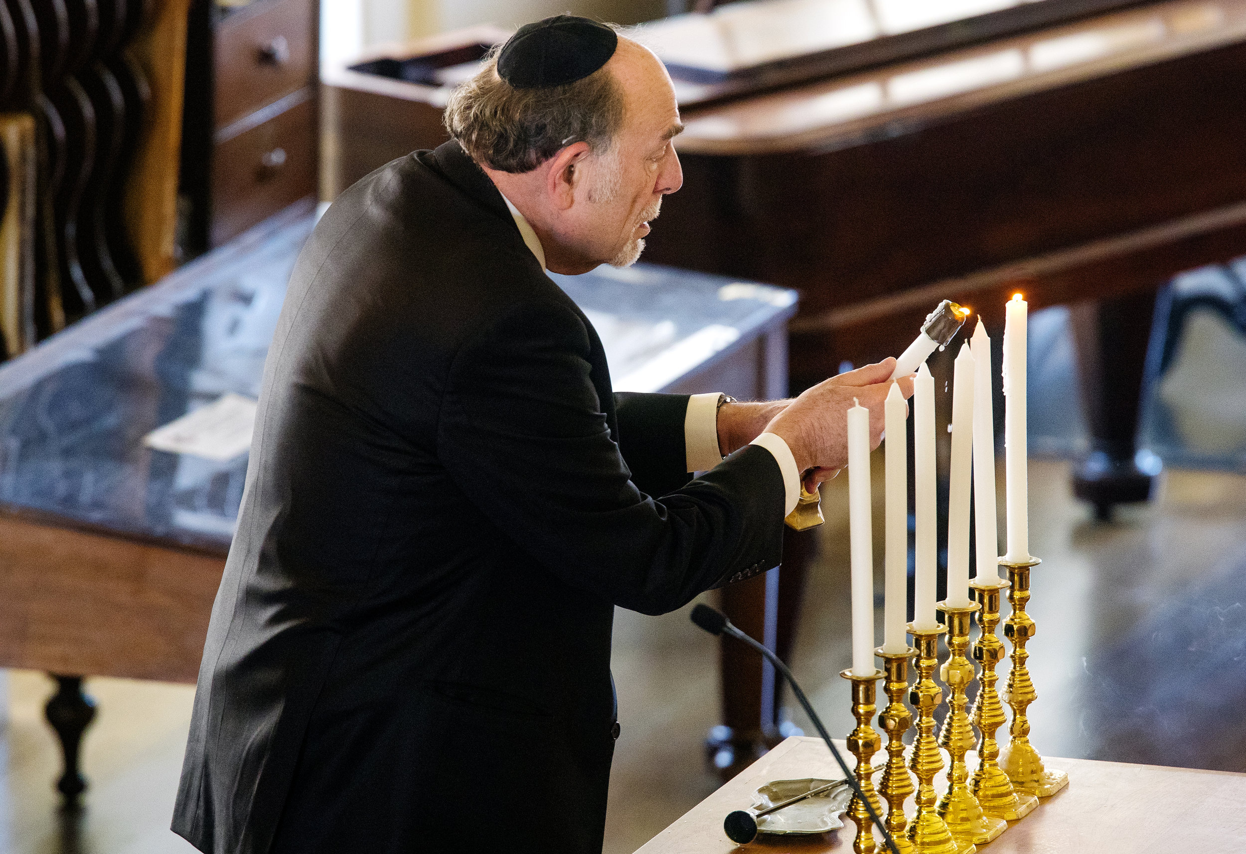 Rabbi Barry Marks lights the seventh candle during a ceremony honoring Yom HaShoah,  Holocaust Remembrance Day, in the Hall of Representatives at the Old State Capitol Thursday, April 12, 2018. [Ted Schurter/The State Journal-Register]
