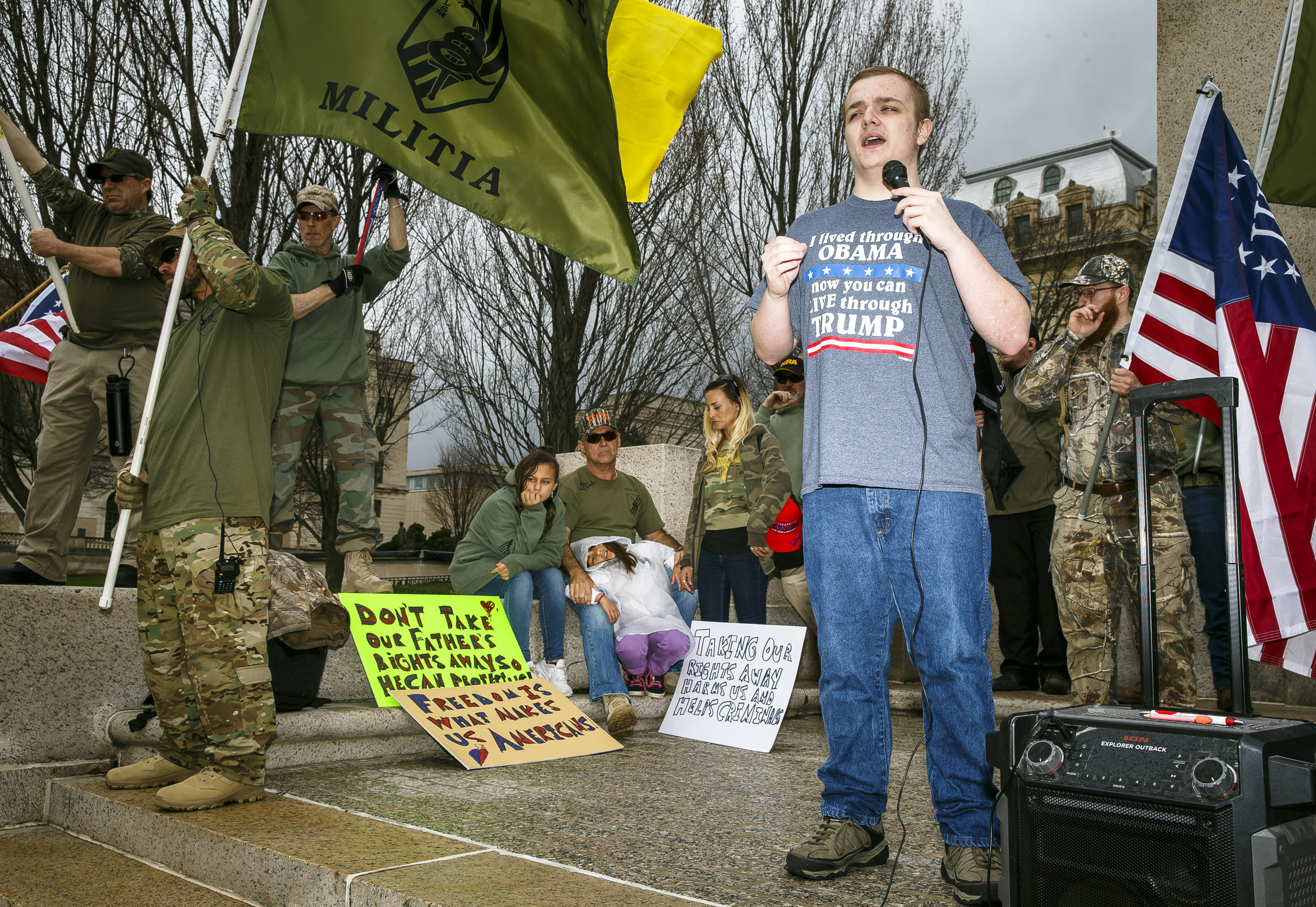 "Kaleb Huddleston, a freshman at Lanphier High School, speaks to a crowd of around 100 people gathered outside the Illinois State Capitol during a nationwide pro Second Amendment rally by the National Constitutional Coalition of Patriotic Americans and organized by the Americans for America Illinois chapter, Saturday, April 14, 2018, in Springfield, Ill. ""I would like to see us all come to an agreement but whenever weÕre pushing to take things away from people and build bigger governments thats not something I can get behind,"" said Huddleston. [Justin L. Fowler/The State Journal-Register]"