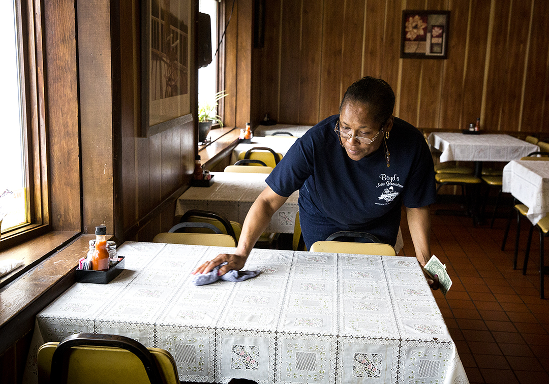 Tammy Calloway says money from the eastside TIF district would be used to make much needed improvements to her restaurant, Boyd's New Generation on South Grand Avenue East. A bill moving through the state legislature would extend the designation for another 23 years. Calloway cleaned tables at the restaurant during the lunch hour Friday, April 13, 2018 in Springfield, Ill. [Rich Saal/The State Journal-Register]