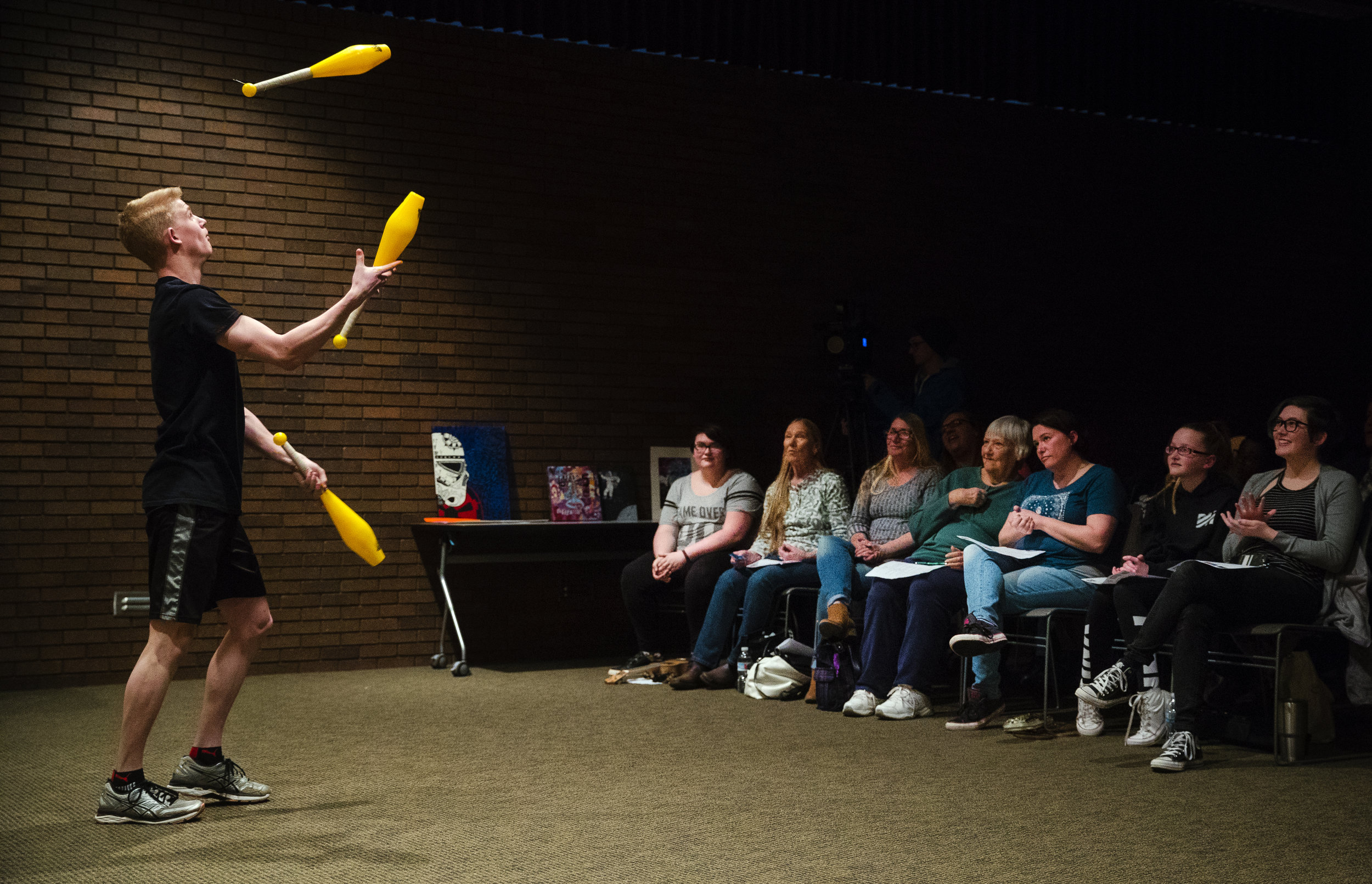 Colton Schmidt of Sacred Heart-Griffin juggles during the inaugural Mayor's Youth Council All City Talent Show at Lincoln Library Wednesday, April 18, 2018. Colin Gwillim of Lutheran High School won first place in the Visual Art category and Southeast High School's Wynton Gage won first place in the performance category. [Ted Schurter/The State Journal-Register]